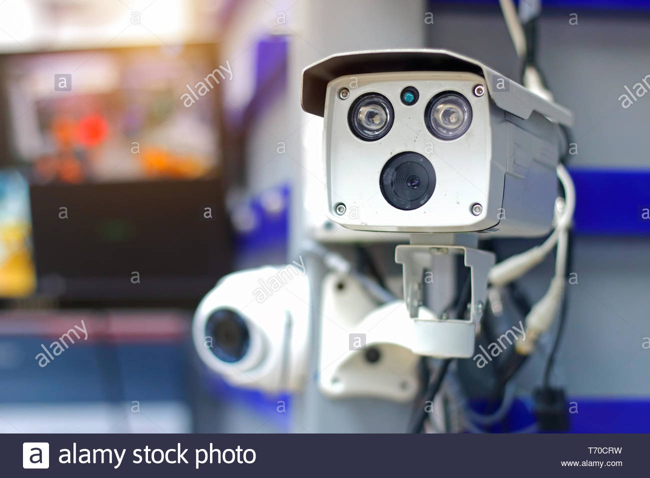 CCTV camera (closed circuit camera) surveillance Safety system with bokeh background - Stock Image