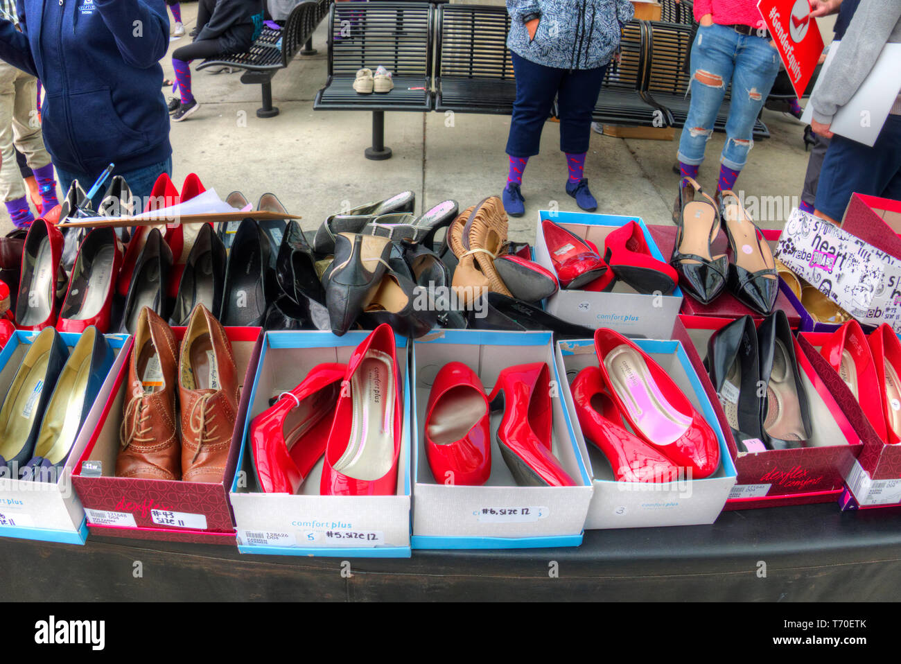 Boxes of ladies high heel shoes to be used in a Walk a Mile in Her Shoes campaign to raise awareness for gender equality. - Stock Image