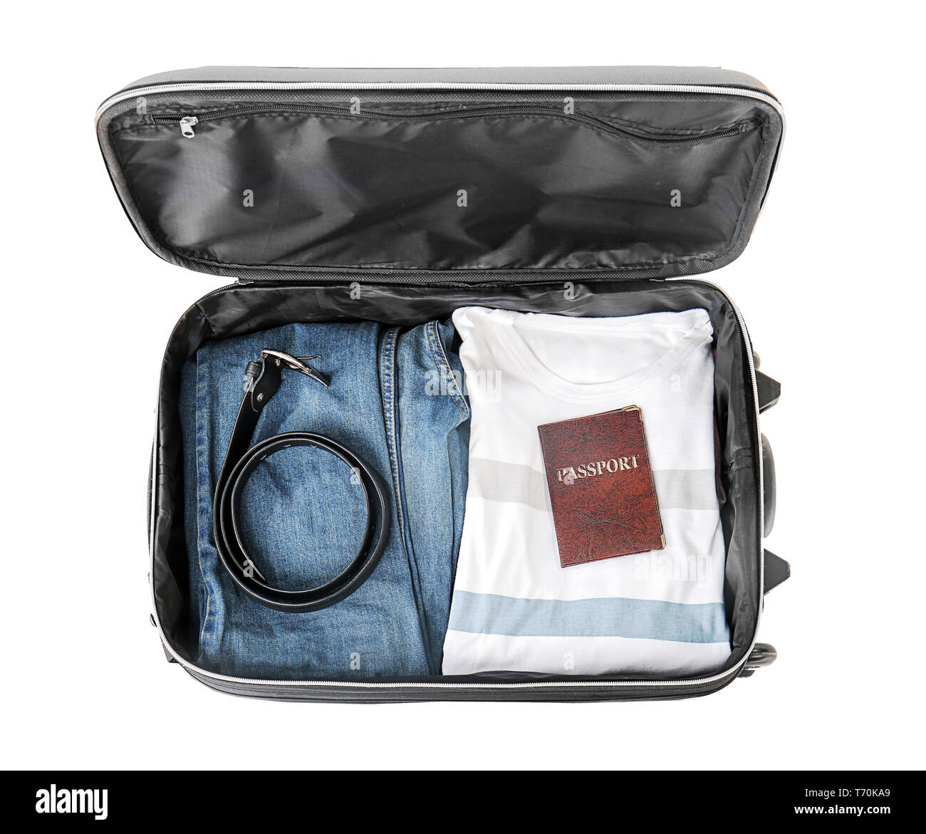 Open suitcase with packed things on white background, top view - Stock Image