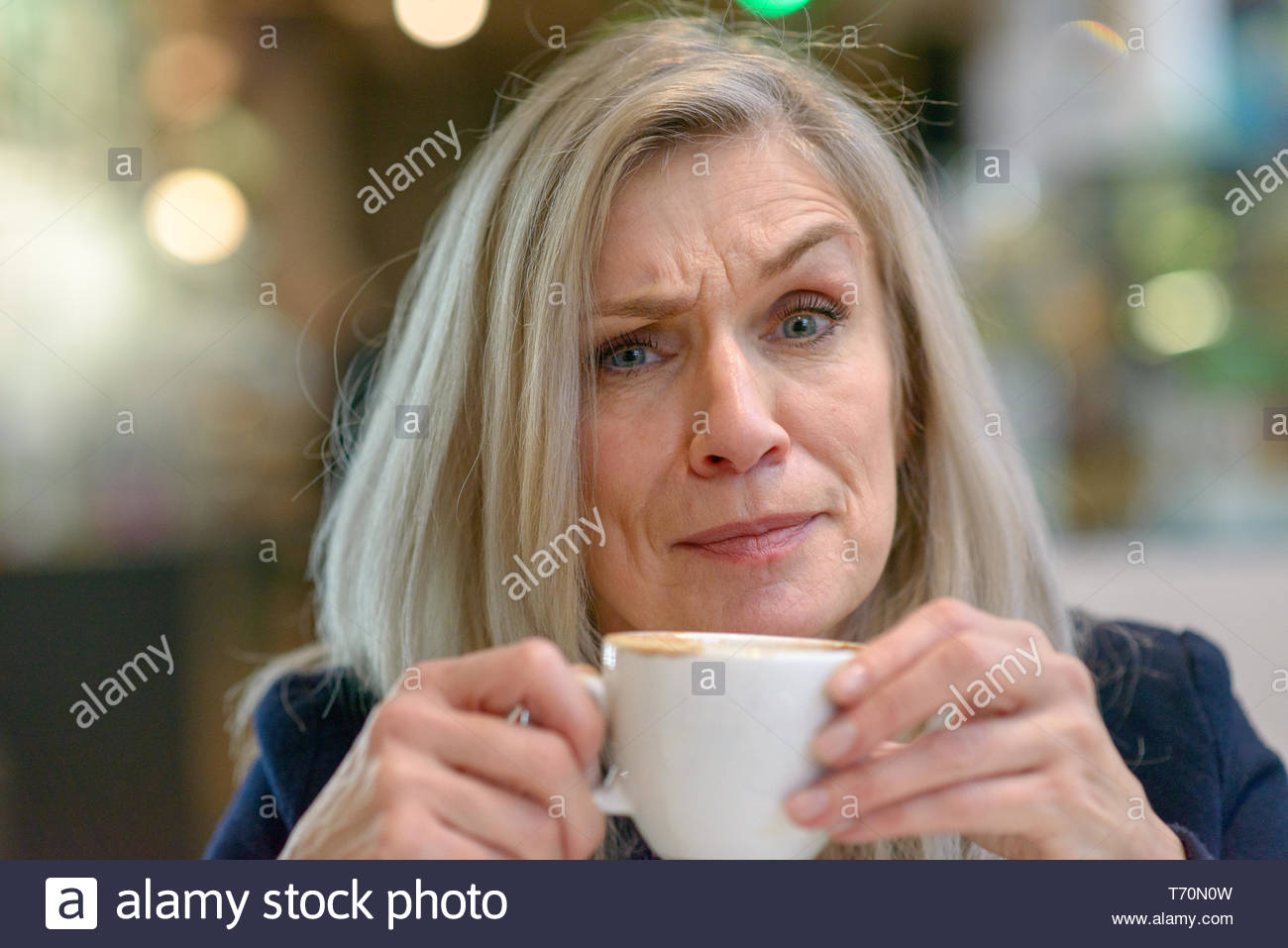 Puzzled or disbelieving middle aged woman - Stock Image
