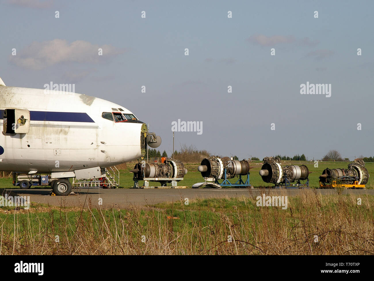 Scrapping a Boeing 707. Classic airliner at the end of its life being stripped. Disposed of. Dismantling retired jet plane. Parts recovery. Engines - Stock Image