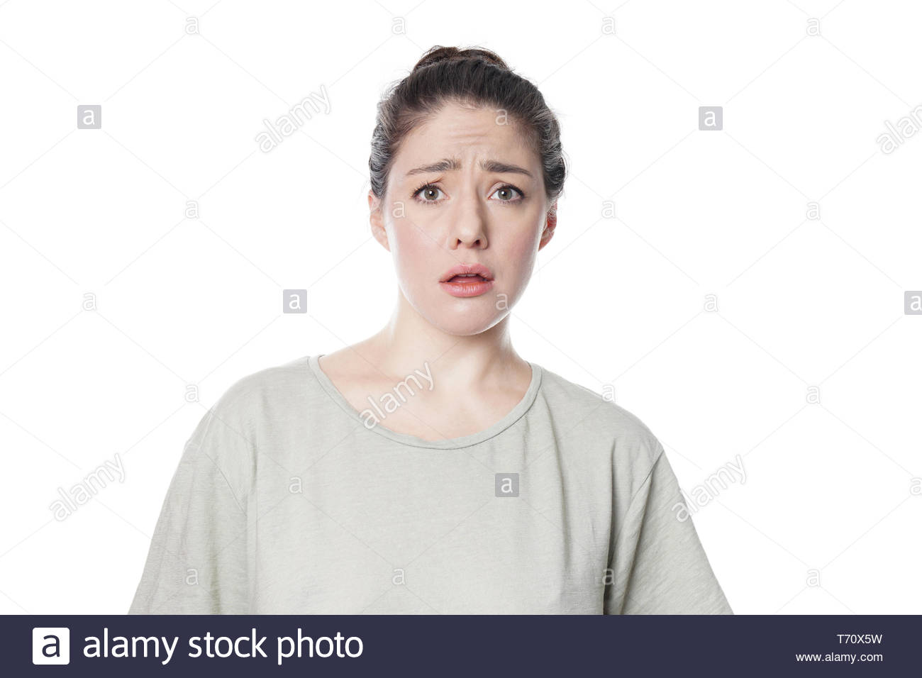 dumbfounded affronted young woman frowning with disbelief Stock Photo