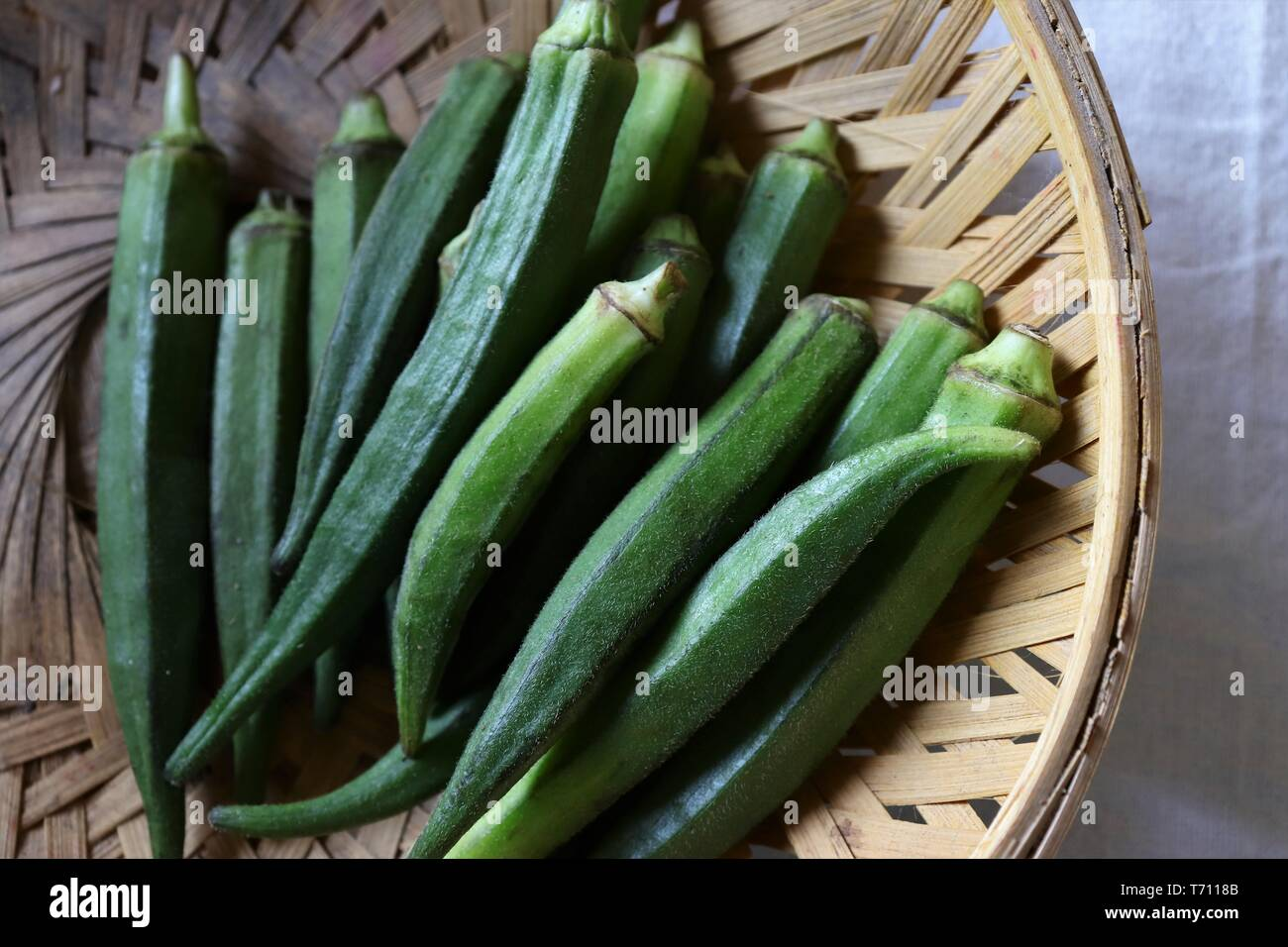Close-up of Okra/ ladies' finger in a bamboo basket - Stock Image