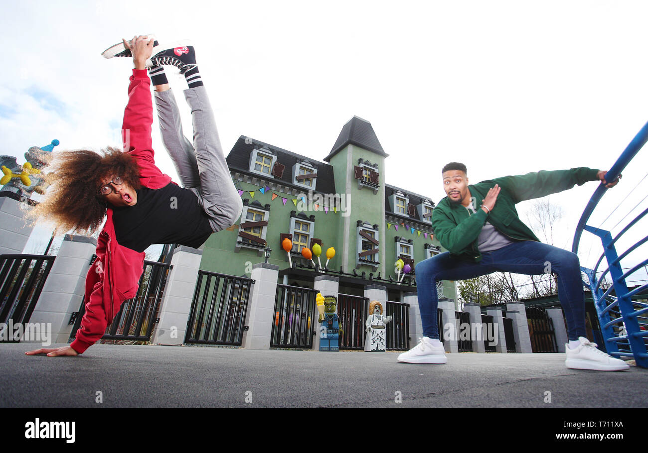 Hair-raising flips and tricks from dancing Diversity duo Jordan Banjo (26) and Perri Kiely (23). The pair were invited down to the LEGOLAND® Windsor Resort for a sneak peek of the new ride – The Haunted House Monster Party – ahead of its grand opening on 13 April 2019.  Whilst at LEGOLAND, the boys – who are no strangers to spending time flipped upside down as part of their impressive dance careers – showed off their gravity-defying skills and signature party tricks around the Resort as it prepares for the ride's opening. They were spotted performing flips outside the front of the Haunted Hous Stock Photo