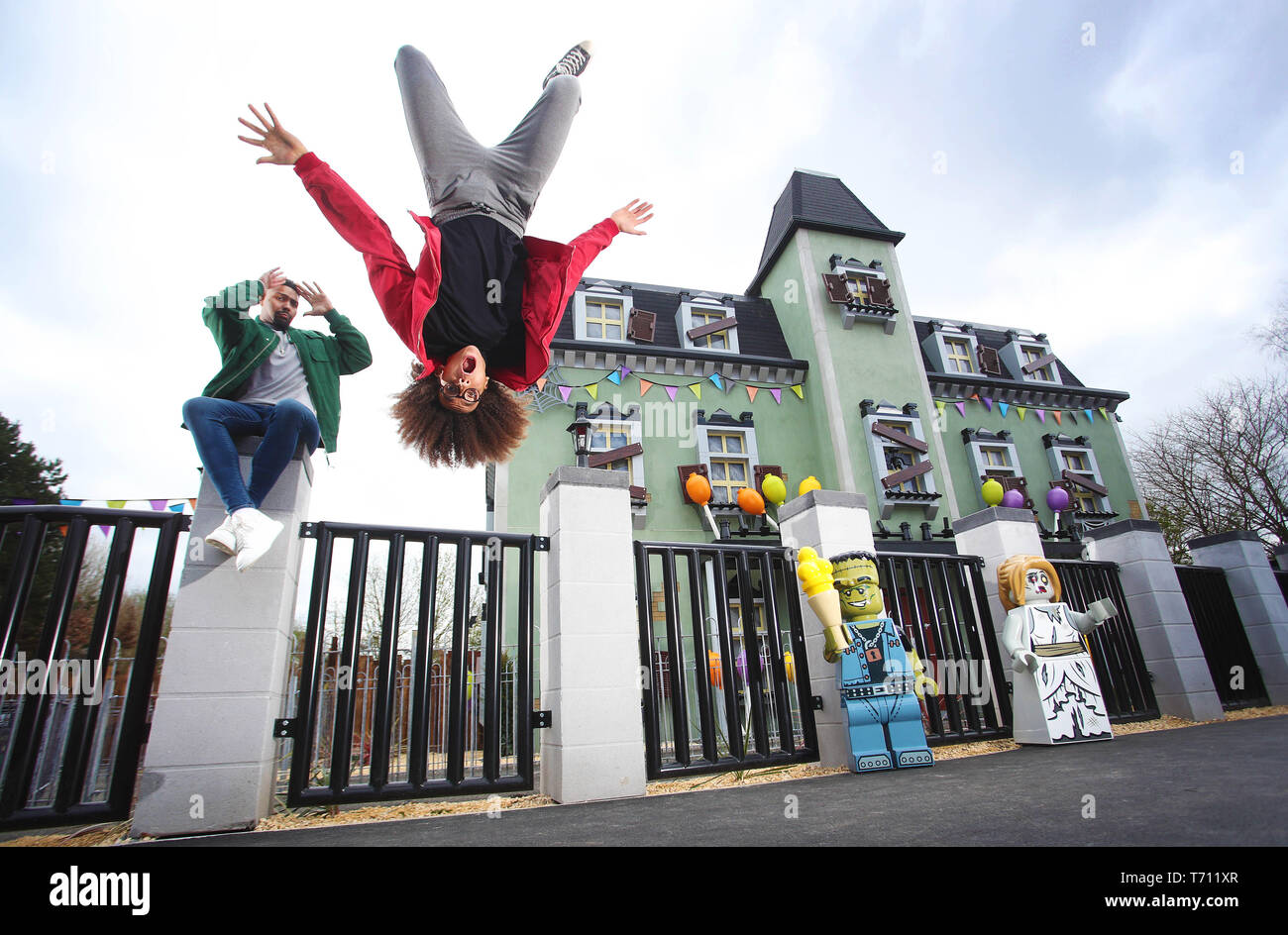 Hair-raising flips and tricks from dancing Diversity duo Jordan Banjo (26) and Perri Kiely (23). The pair were invited down to the LEGOLAND® Windsor Resort for a sneak peek of the new ride – The Haunted House Monster Party – ahead of its grand opening on 13 April 2019.  Whilst at LEGOLAND, the boys – who are no strangers to spending time flipped upside down as part of their impressive dance careers – showed off their gravity-defying skills and signature party tricks around the Resort as it prepares for the ride's opening. They were spotted performing flips outside the front of the Haunted Hous - Stock Image