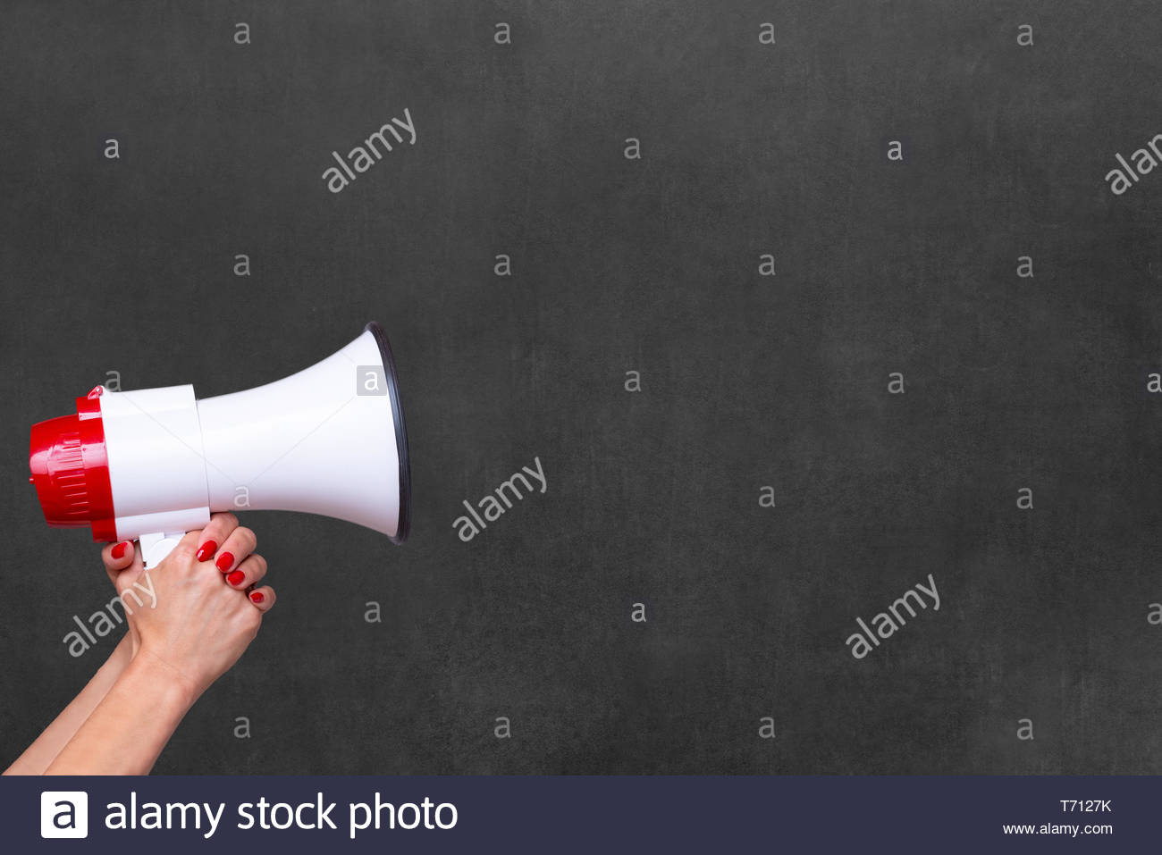 Person holding a megaphone or loud hailer - Stock Image