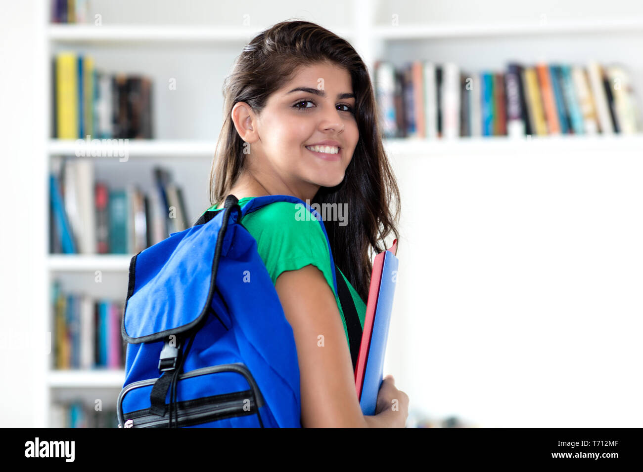 Young mexican female student at library of university - Stock Image