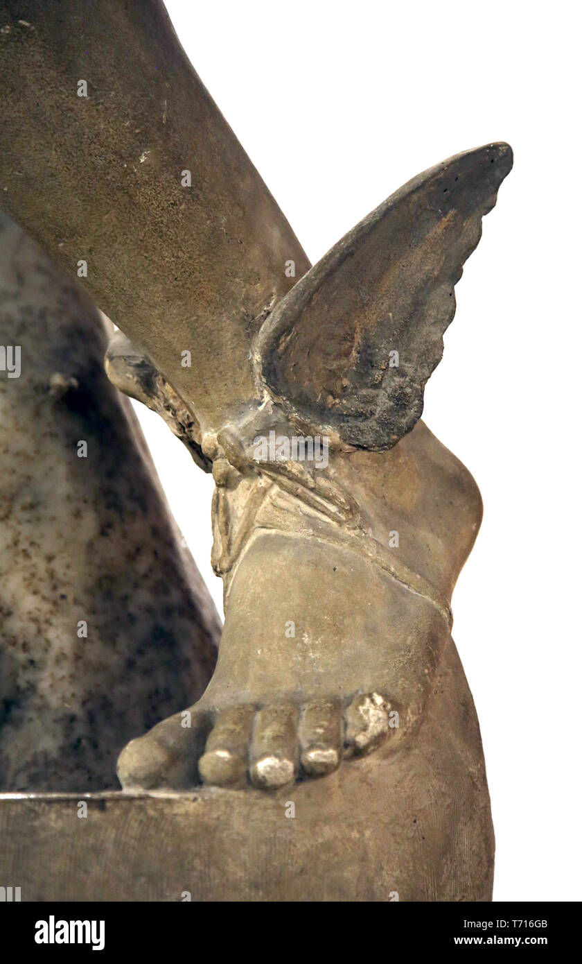 Statue of Mercury (Hermes). Detail of talaria, winged sandals. Italica. 2nd cent. Archaeological Museum of Seville. Andalusia. Spain. - Stock Image