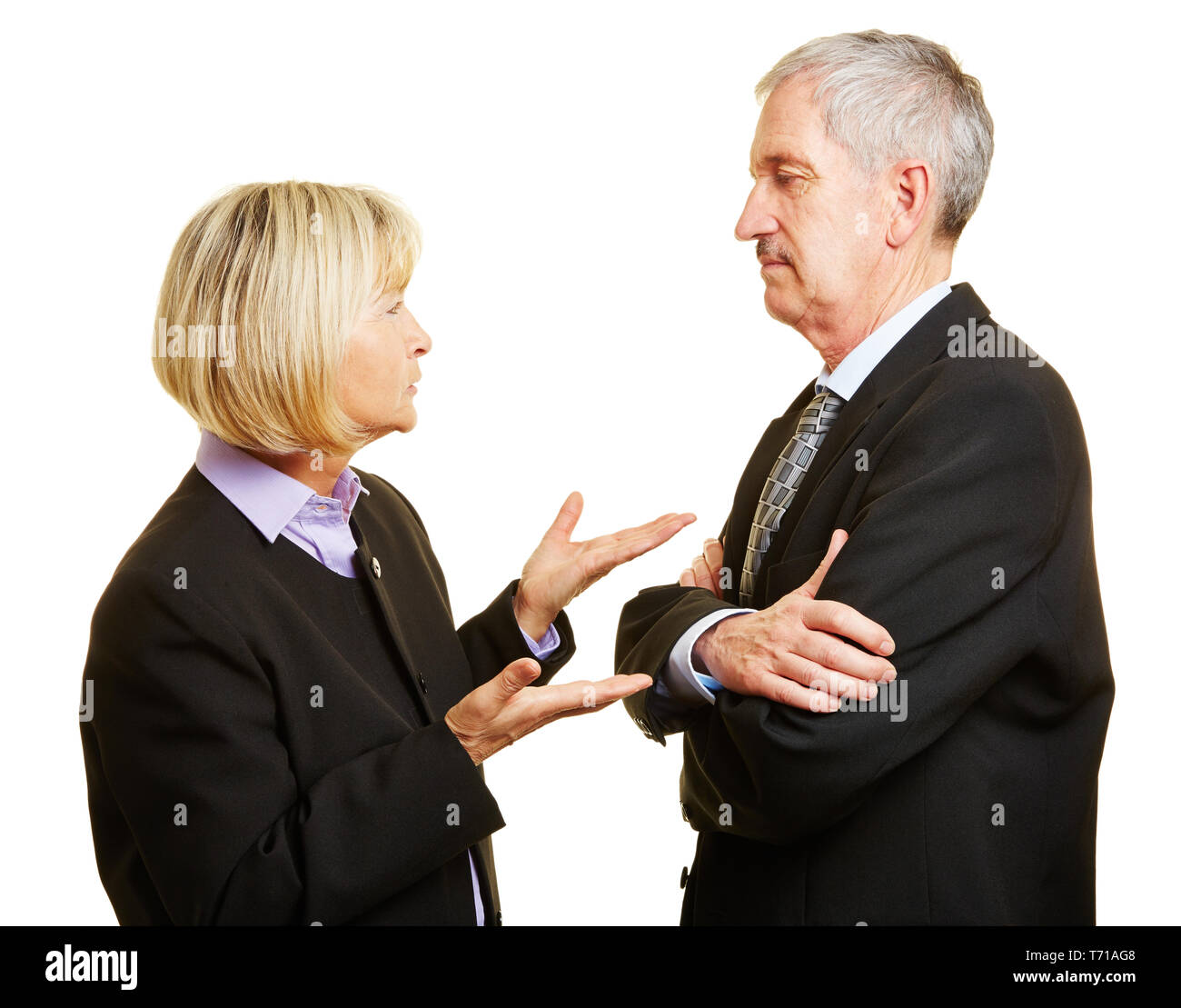 Couple of seniors in suit talking and arguing with each other - Stock Image