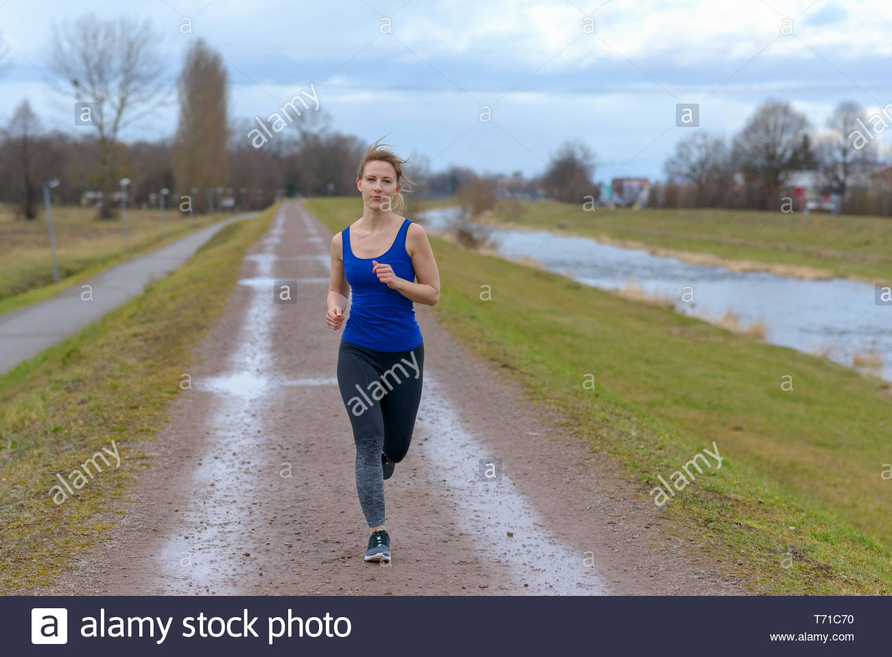 Shapely fit young woman working out in winter - Stock Image