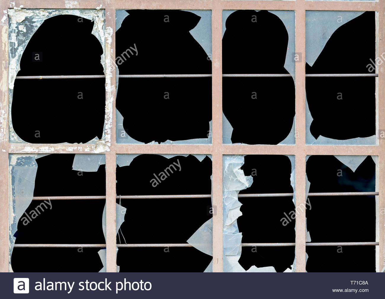 Old window with broken panes of glass - Stock Image