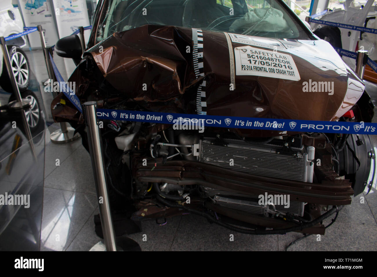 Proton damaged car for show inside the main company. Stock Photo