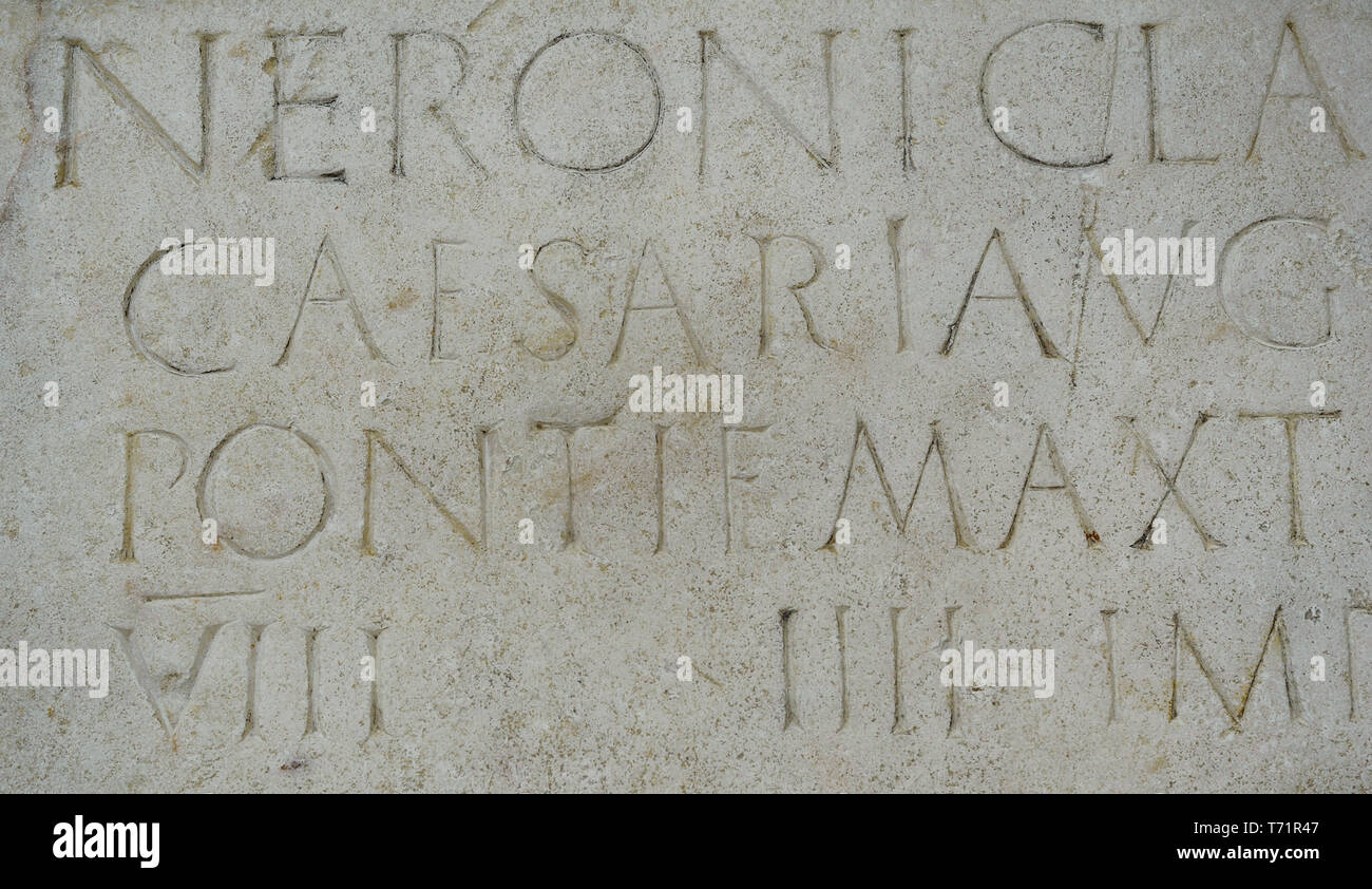 Stone plaque dedicated to emperor Nero (Nero Claudius Caesar Augustus Germanicus)  (37-68 AD) honouring his person and lists his titles: Pontifex Maximus, Tribune, Consul, Emperor and Father of the Homeland. 61-62 AD. Marble. Detail. From the Forum of Augusta Emerita (Merida, Badajoz province, Extremadura, Spain). National Archaeological Museum. Madrid. Spain. - Stock Image
