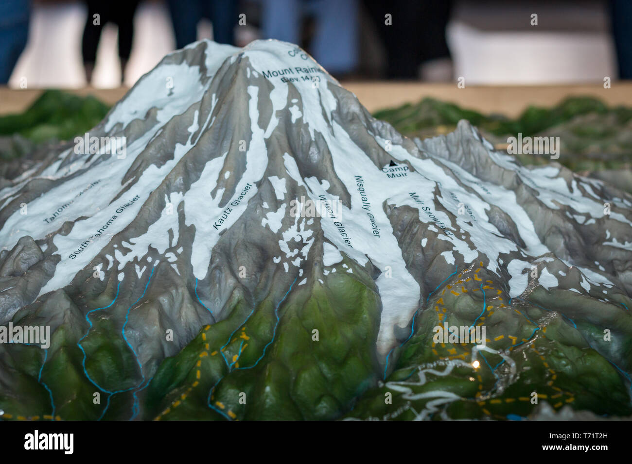 A model of Mt Rainier at the welcome center is labeled with the various glacier names. - Stock Image