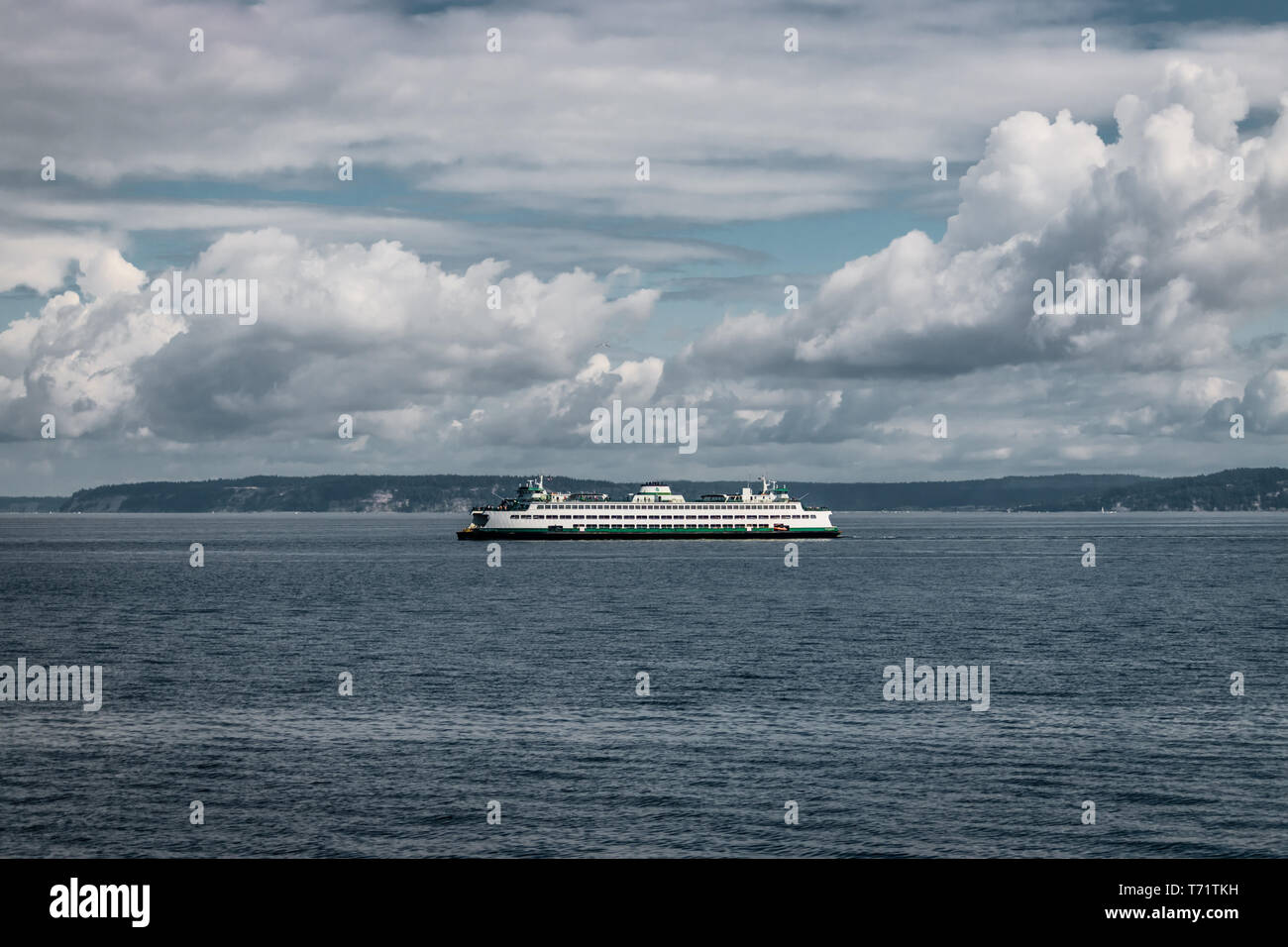 The ferry Walla Walla makes its way on a cloudy summer day from Bainbridge Island to Seattle in the Puget Sound, Washington state. Stock Photo