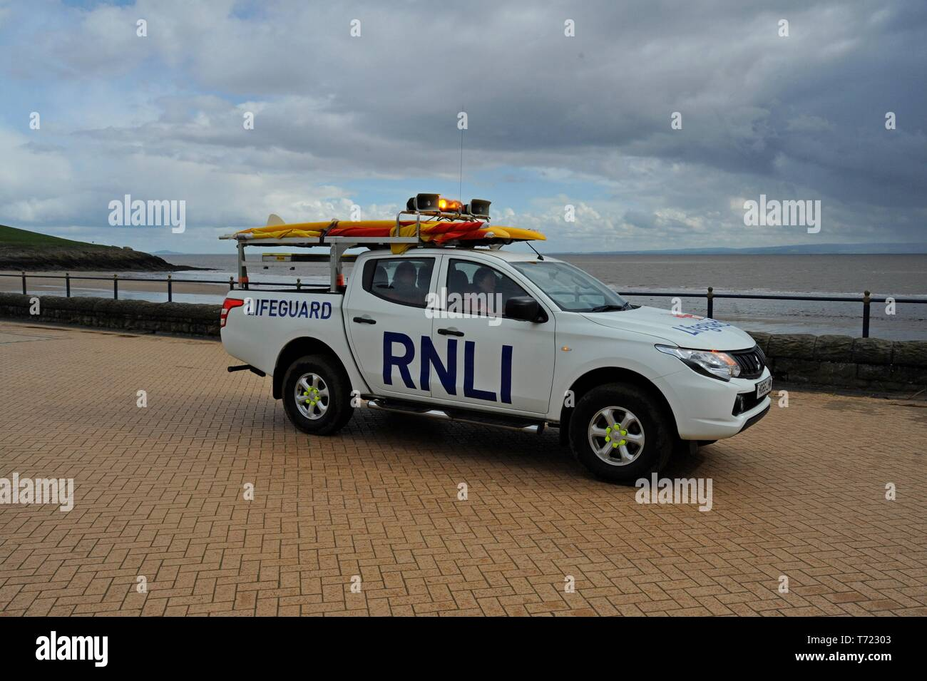 RNLI lifeguards training on the beach and outside the lifeboat station at Barry Island, South Wales Stock Photo
