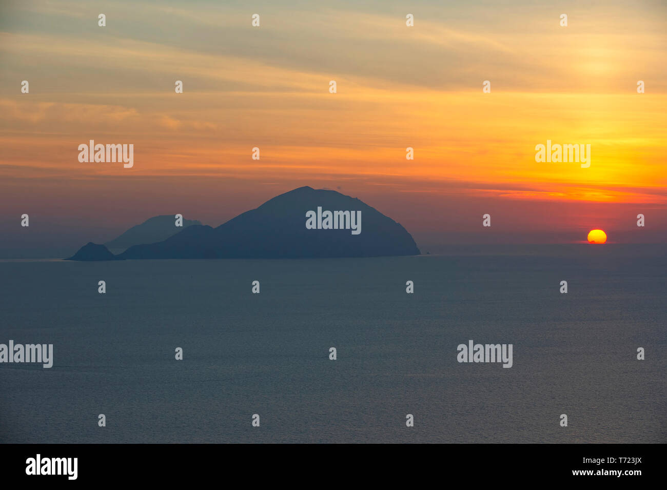 Sunset on Filicudi Island from Pollara, Salina, Aeolianislands,  Sicily, Italy Stock Photo