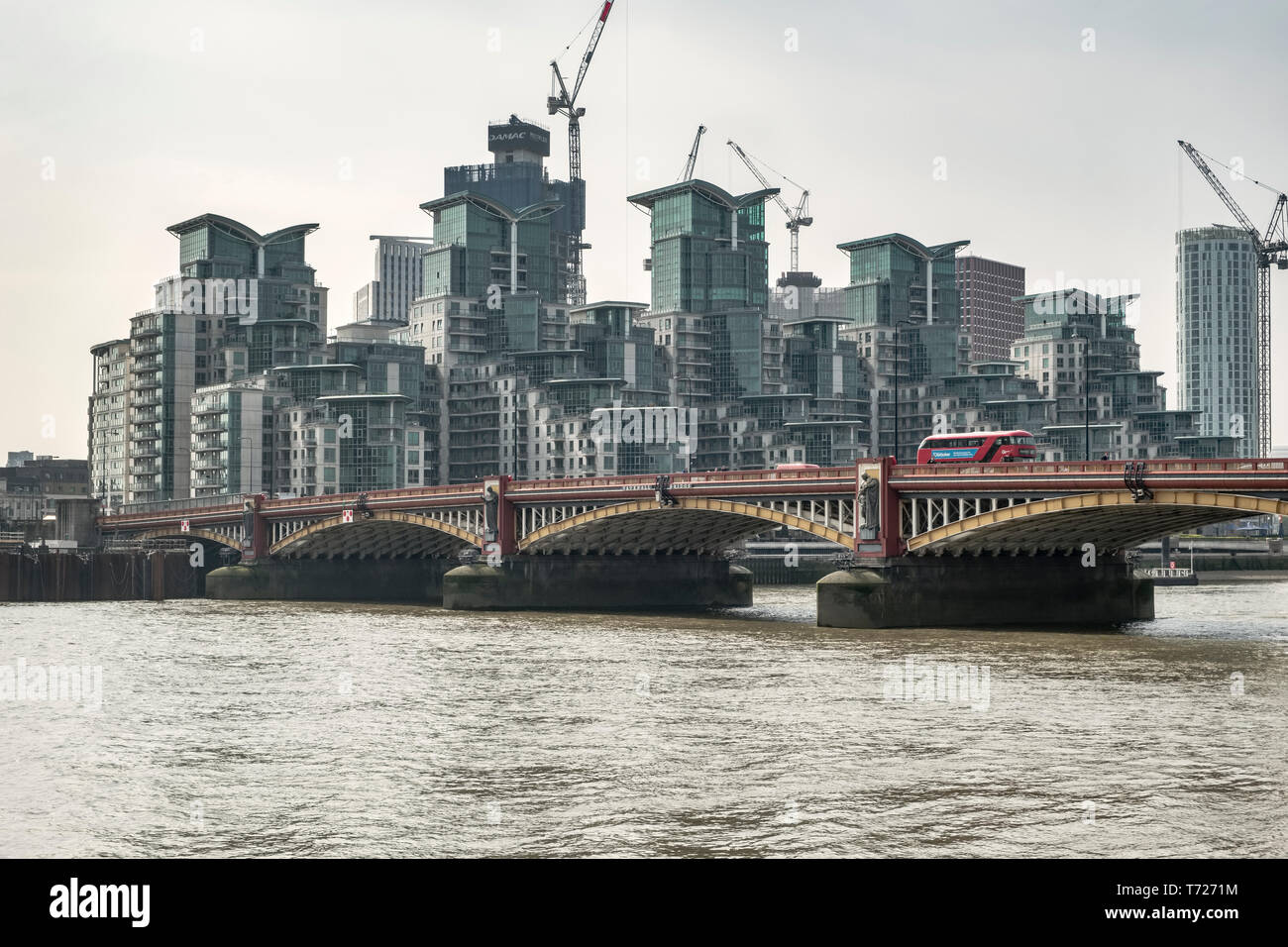 London. Vauxhall Bridge over the River Thames, and the St George Wharf development. This has twice been voted the world's worst building - Stock Image