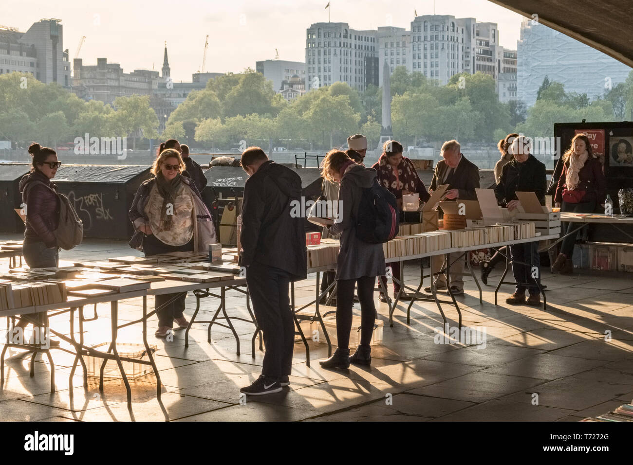 London, UK. The Southbank Centre Book Market on Queen's Walk beneath Waterloo Bridge, a daily outdoor market for secondhand books - Stock Image