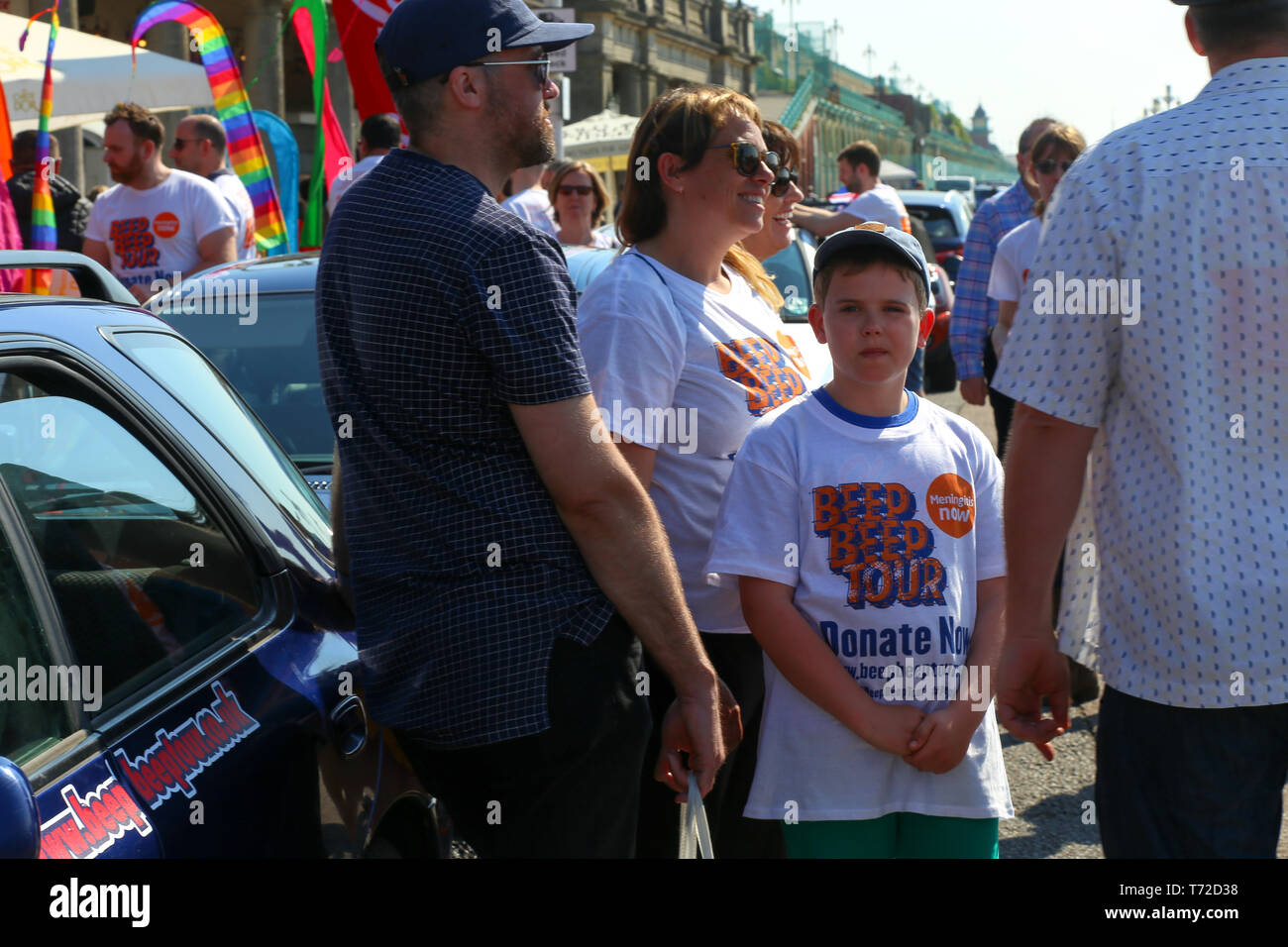Little boy looking the camera, part of the cars competition team charity beep beep tour. Raising Awareness for Meningitis, Brighton. Easter 2019 - Stock Image