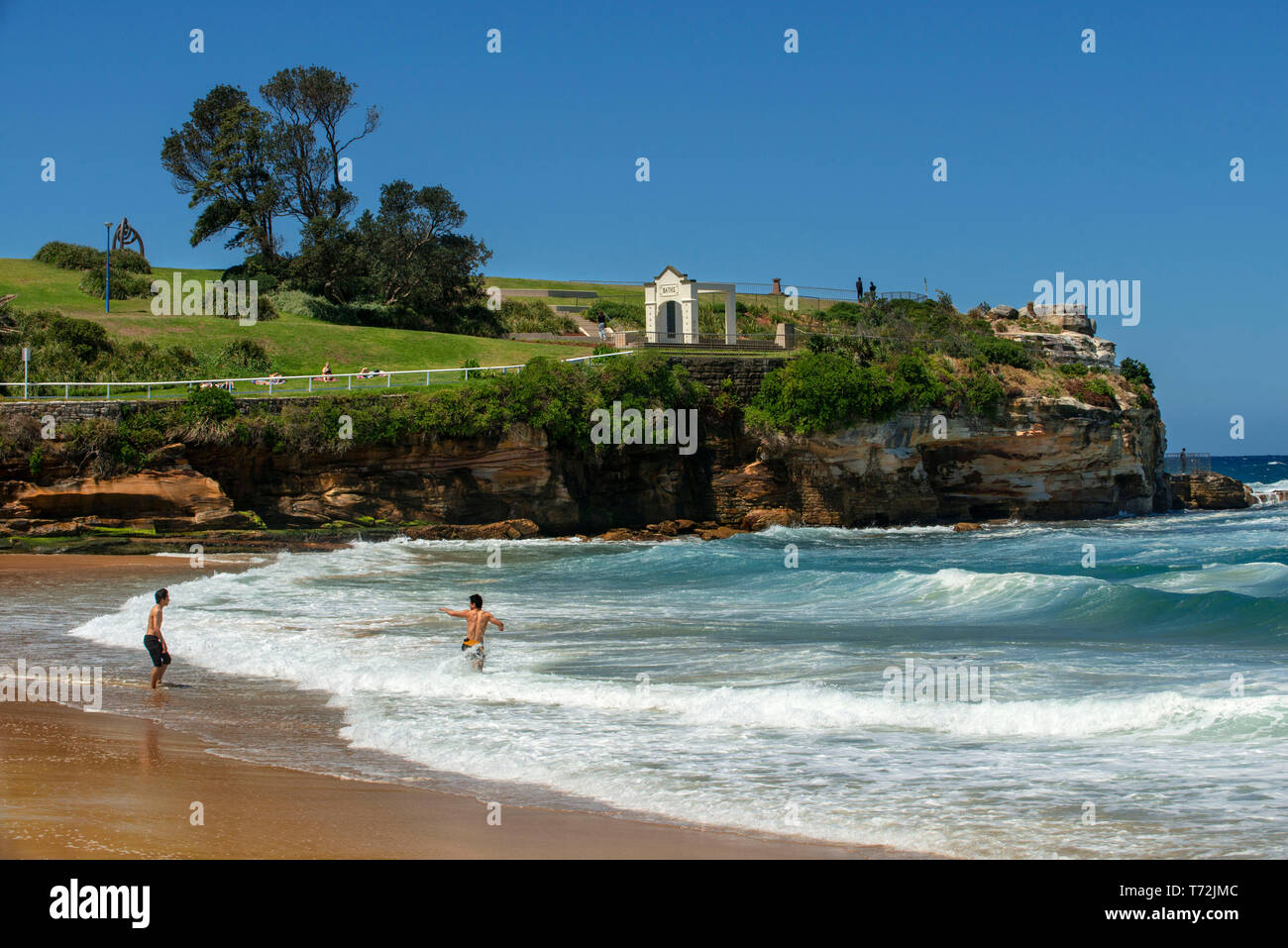 The Bondi beach to Coogee walk is a coastal walk in Sydney New South Wales, Australia. People in Coogee beach Dolphins Point and Giles Baths - Stock Image