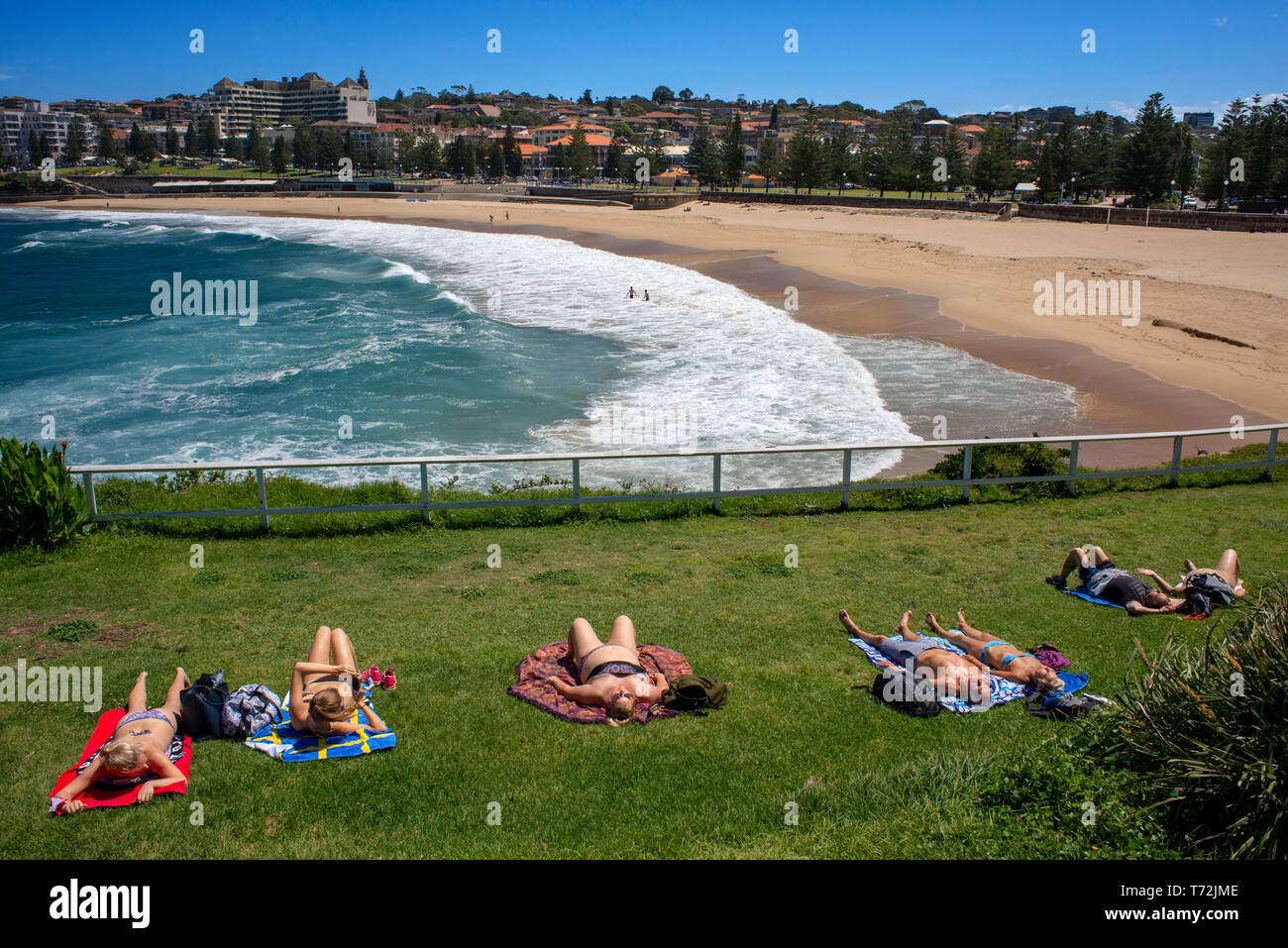 The Bondi beach to Coogee walk is a coastal walk in Sydney New South Wales, Australia. Sunbath in Coogee beach Dolphins Point and Giles Baths - Stock Image