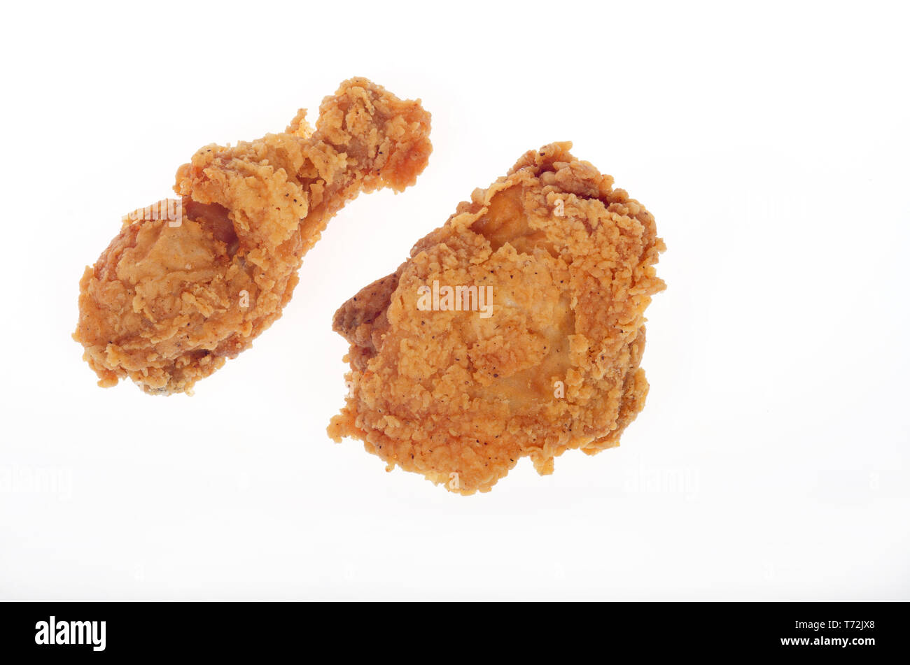 2 pieces crispy deep fried chicken 1 thigh and 1 drumstick - Stock Image