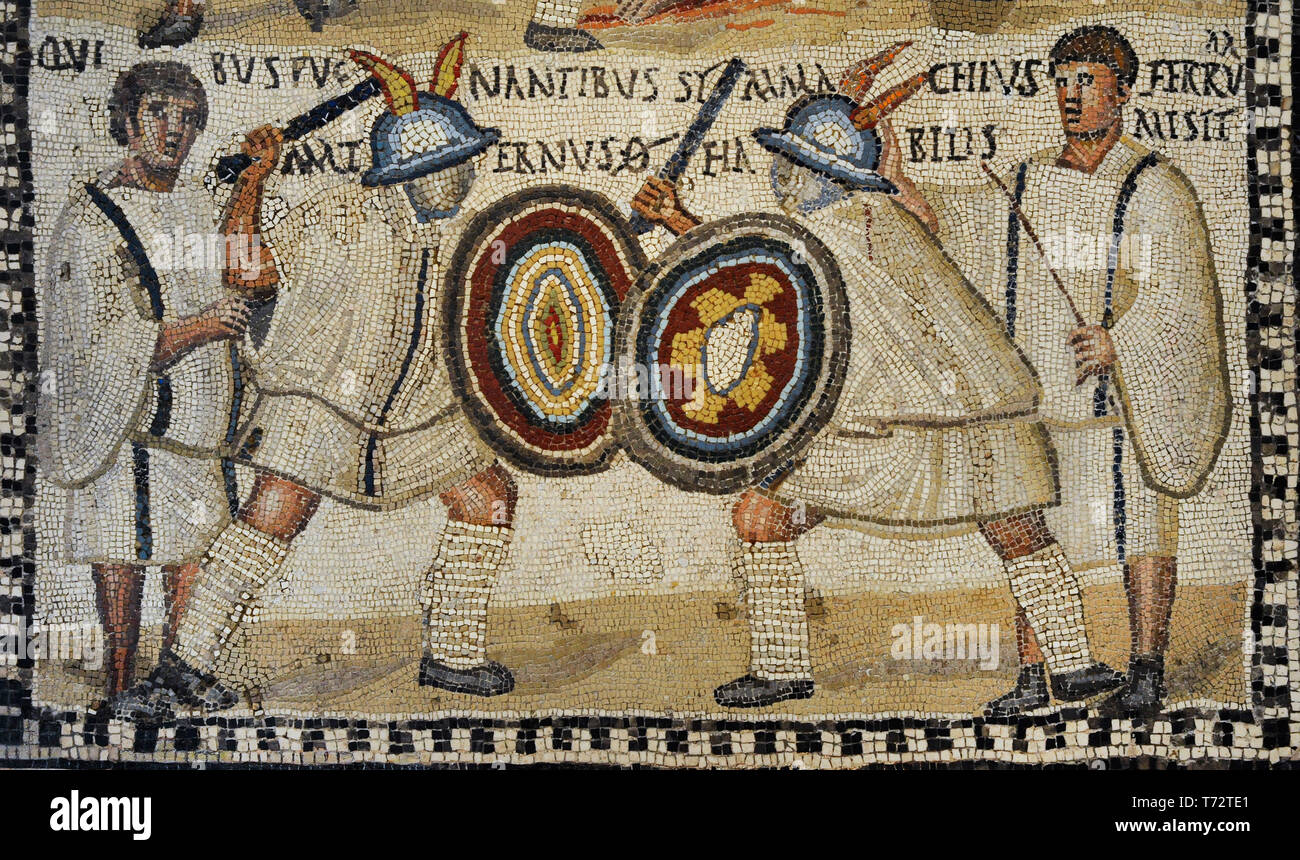 Roman mosaic depicting a Gladiator fight. Detail of the lower part with the murmillones Symmanchus and Maternus are fighting in the arena cheered by the lanistae. 3rd century AD. Limestone and vitreous paste. From Rome (Italy). National Archaeological Museum. Madrid. Spain. - Stock Image