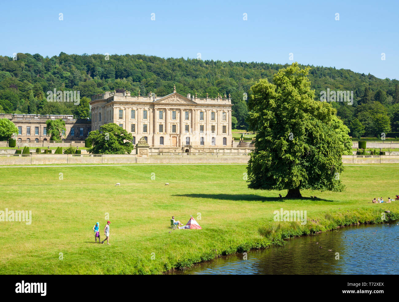 Family fun near Chatsworth House park with river Derwent parkland and woods Derbyshire England UK GB,  Europe - Stock Image