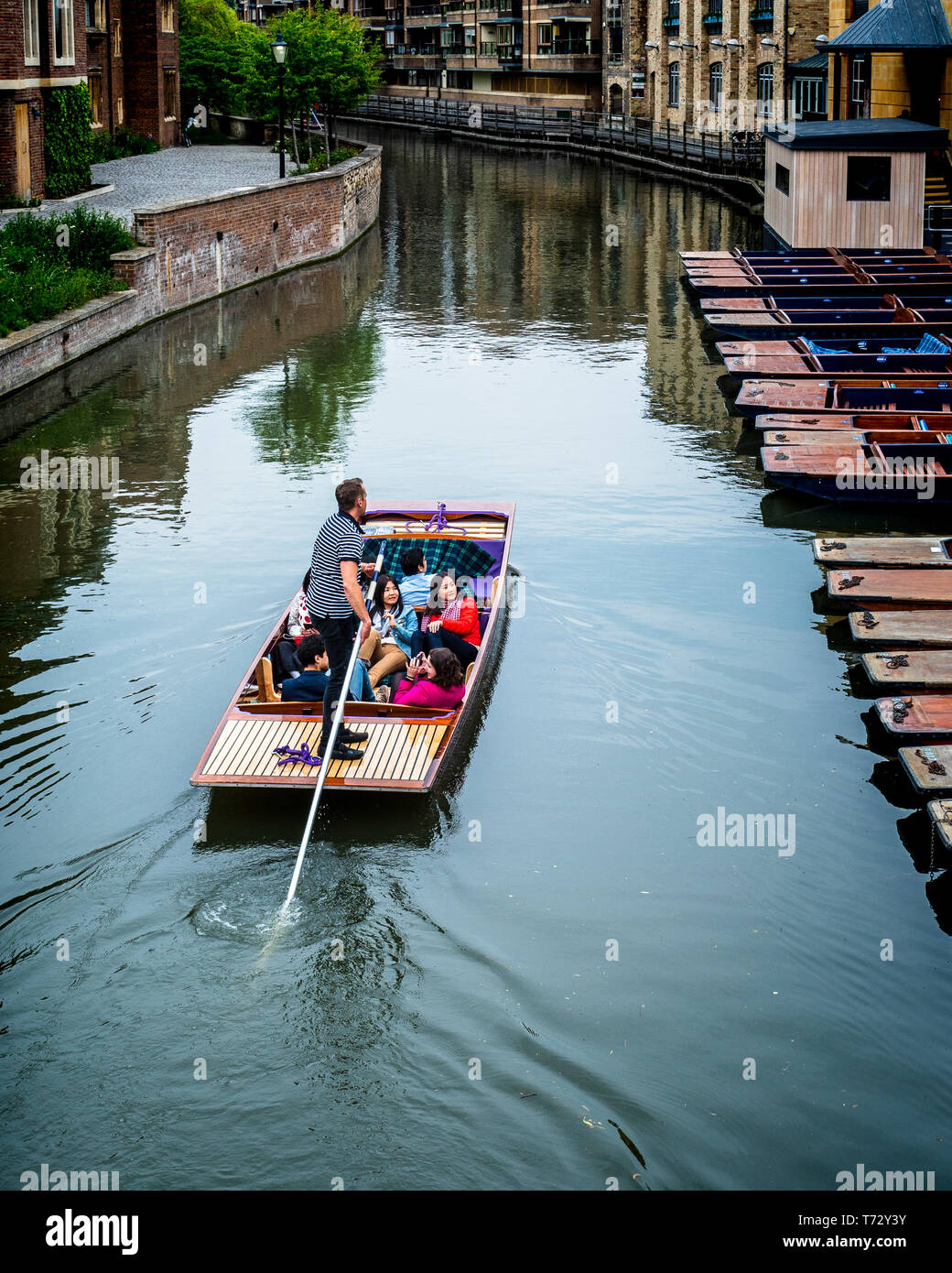 Cambridge Tourism - tourists take a punt along the River Cam in central Cambridge UK - Cambridge Punting - Stock Image