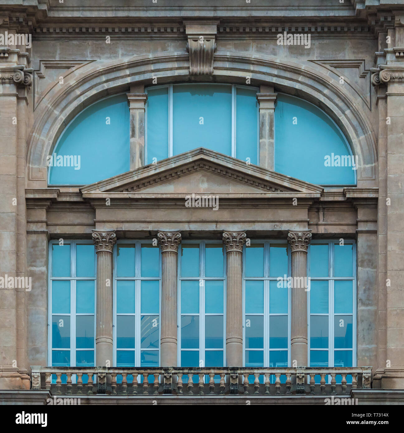 Barcelona, Catalonia, Spain - November 16, 2018: Several windows on the facade of the National Art Museum of Catalonia front view closeup - Stock Image