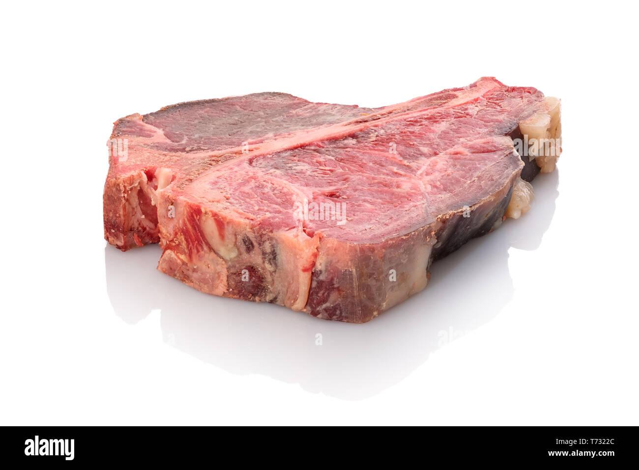 Dry aged t-bone steak raw white isolated Stock Photo