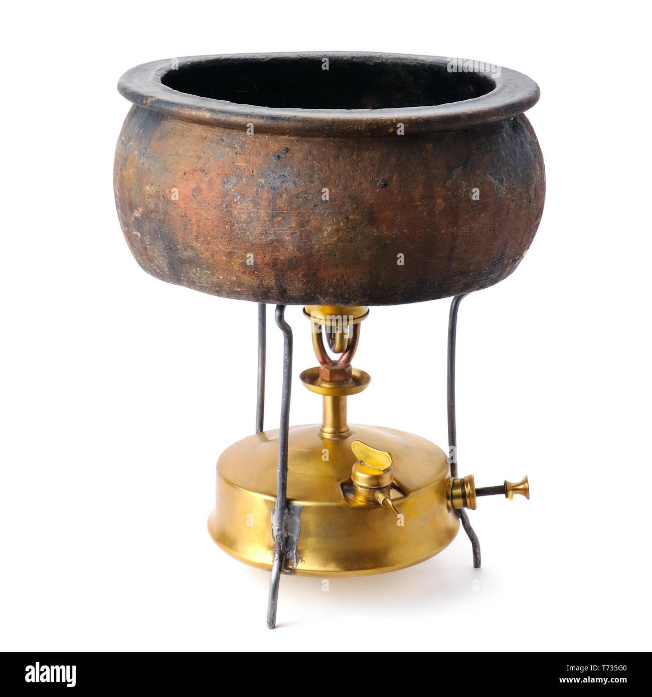 kerosene stove and a ceramic pot isolated on white background - Stock Image