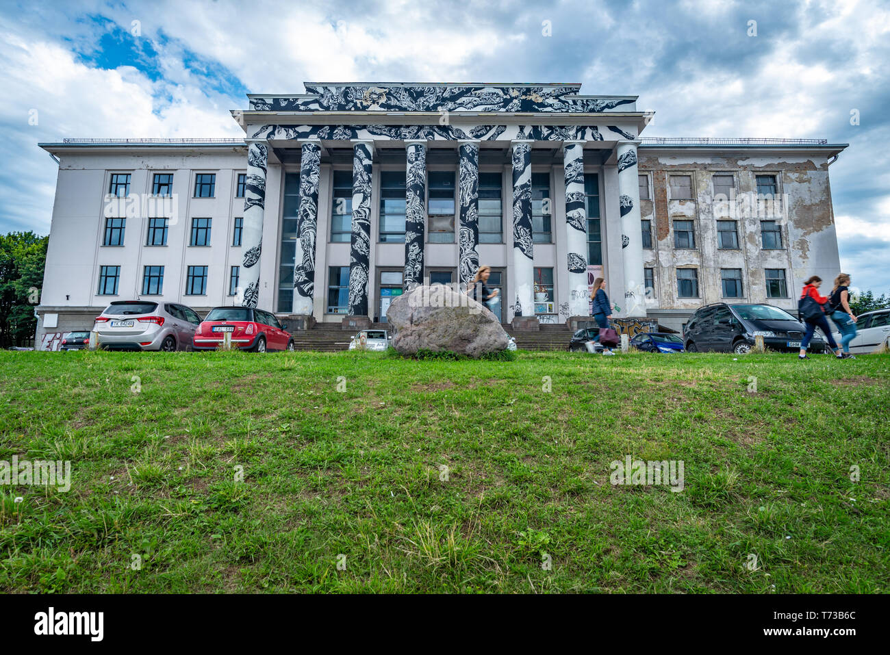 VILNIUS, LITHUANIA - JULY 5, 2018: Low angle view of the Soviet era neoclassical building adorned with graffiti located on Tauras hill, Vilnius Stock Photo