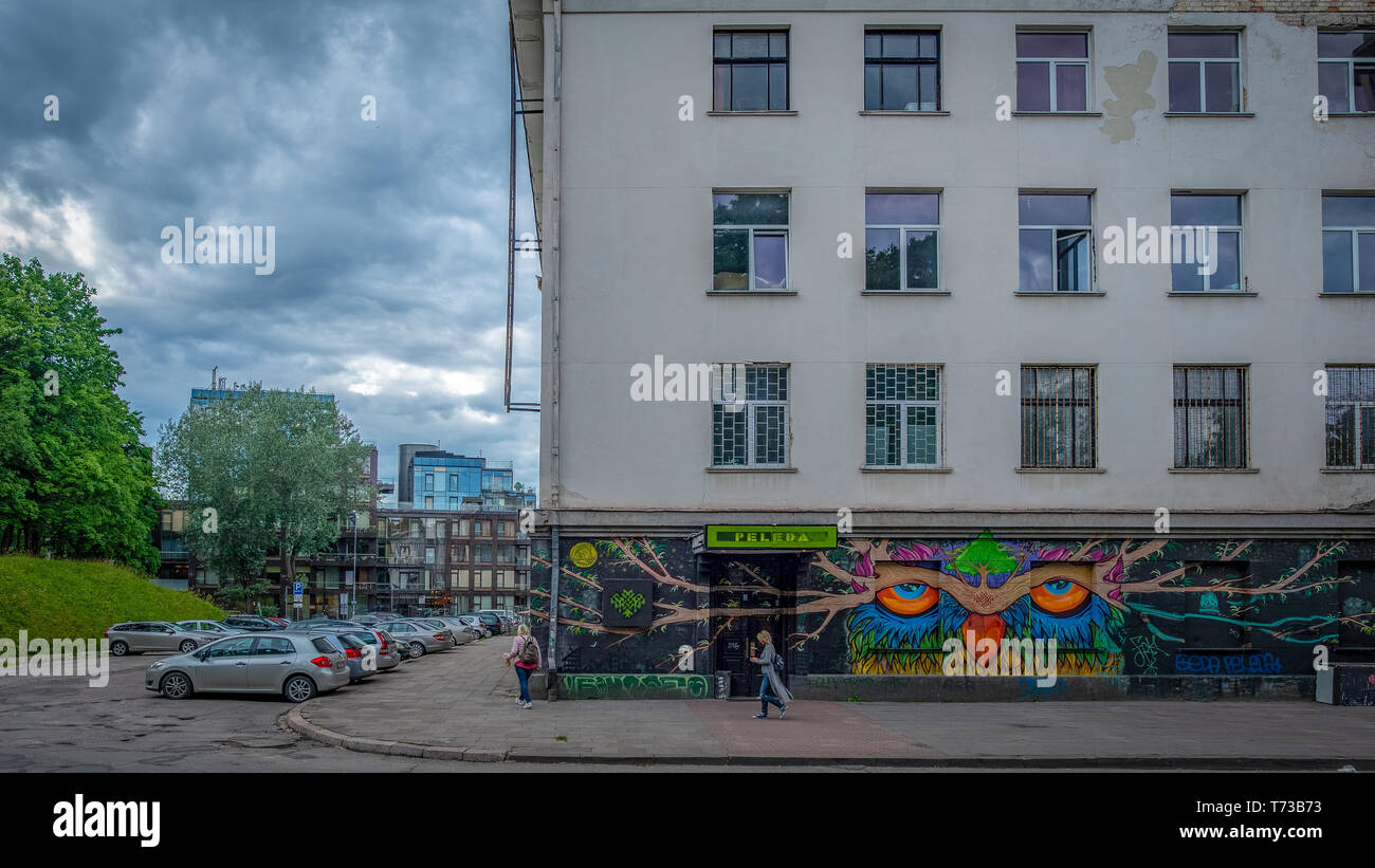 VILNIUS, LITHUANIA - JULY 5, 2018: Partial view of a Soviet era neoclassical building and the entrance to a discotheque, Vilnius Stock Photo