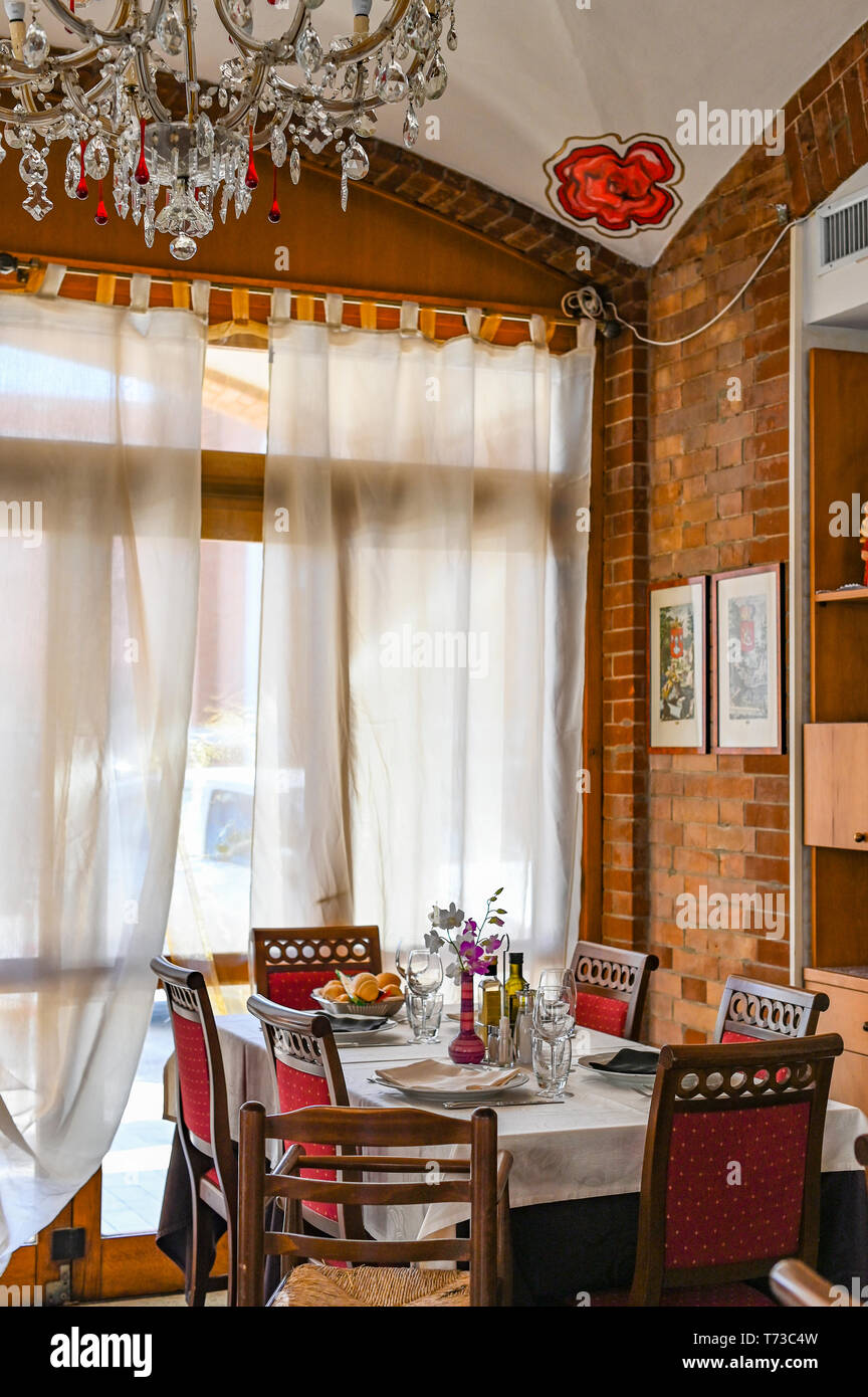 The Interior Of A Traditional Italian Restaurant The Decor Of Flowers And Antique Furniture Table Near The Window Stock Photo Alamy