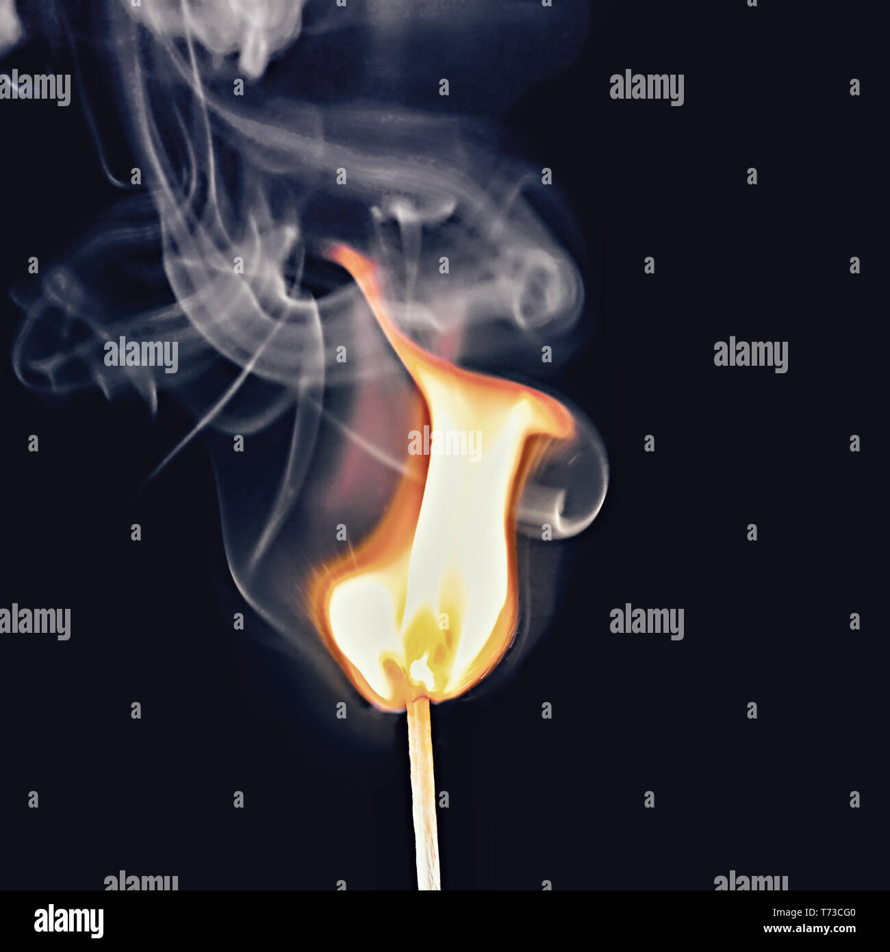 expressionistic smoke development and visible flame of a burning match, isolated on black background. The smoke forms swirls in transparent shades of  - Stock Image