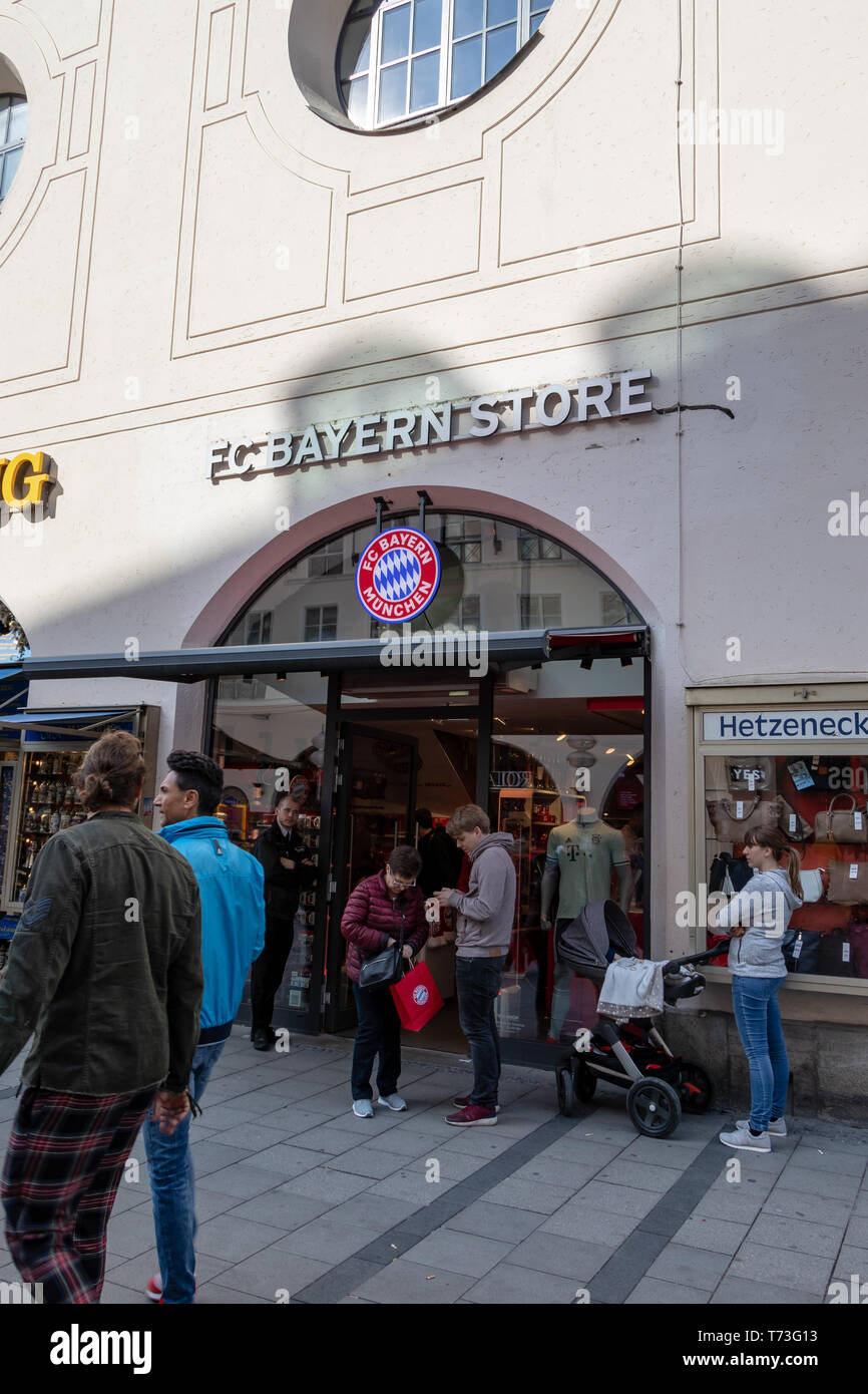 MARIENPLATZ, MUENCHEN, APRIL 6, 2019: trourist walking in and out of the FC Bayern store - Stock Image