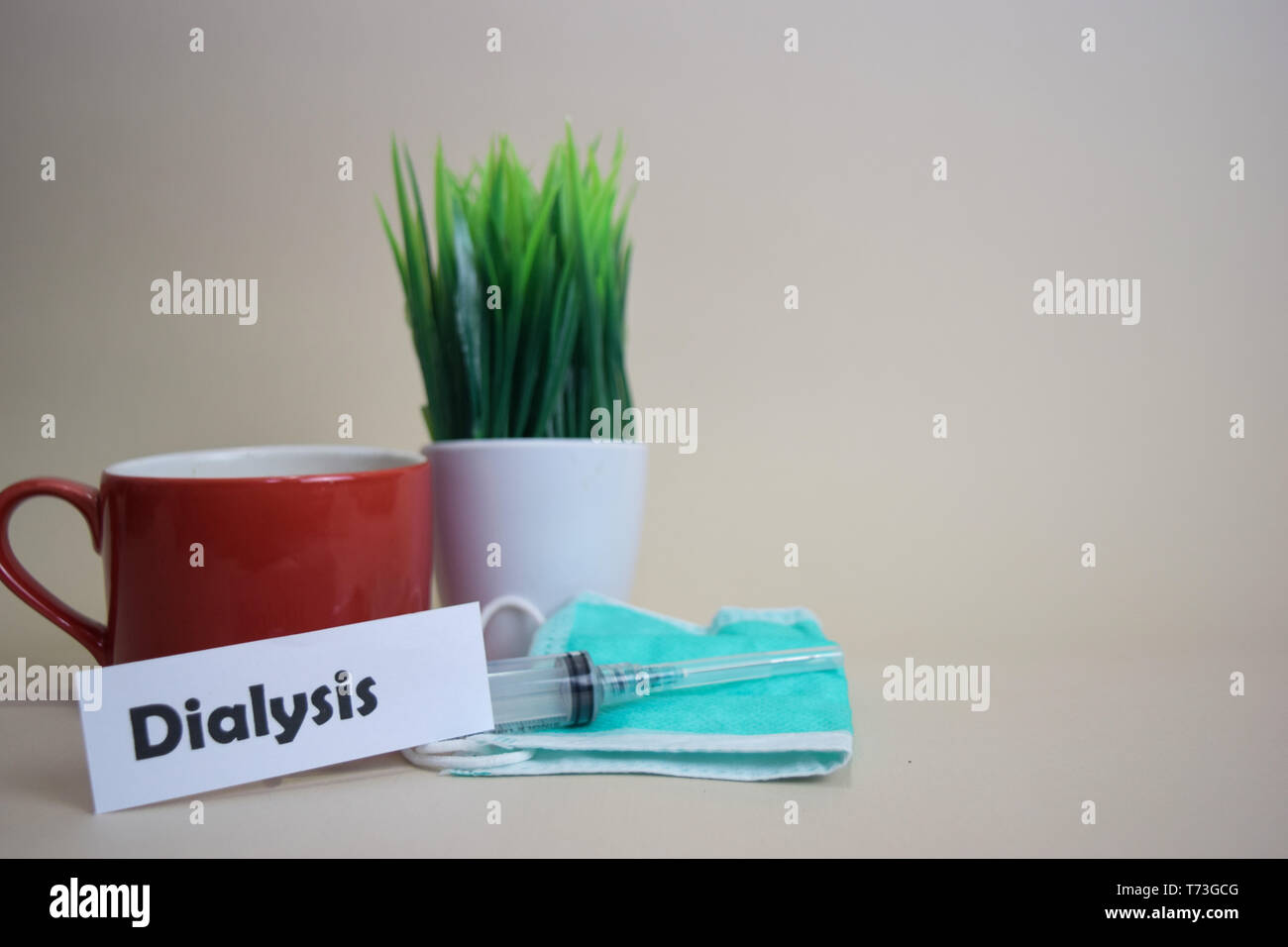 Dialysis text, grass pot, coffee cup, syringe, and face green mask. Healtcare/Medical and Business concept - Stock Image