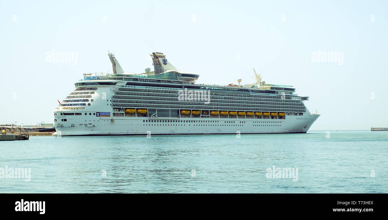 Malaga, Spain - August 07, 2018. Royal Caribbean Navigator of the Seas cruise ship docked at the port of Malaga city, Costa del Sol, Malaga Province,  - Stock Image