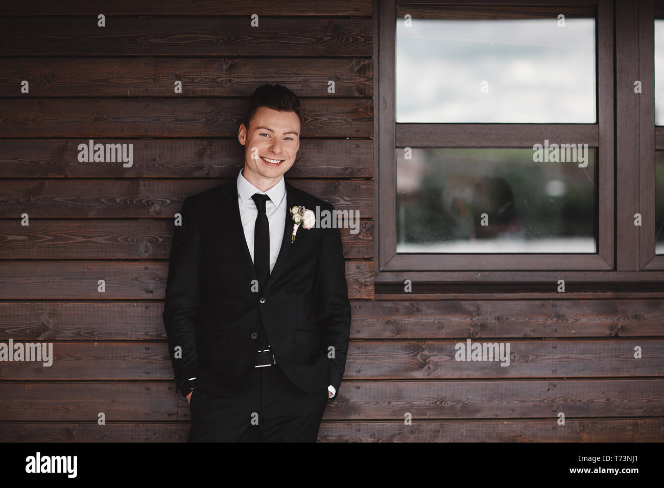 Man's style. Elegant young man. Close-up portrait of the man in a luxury classic trendy suit. portrait of the groom. Men's beauty, fashion. - Stock Image