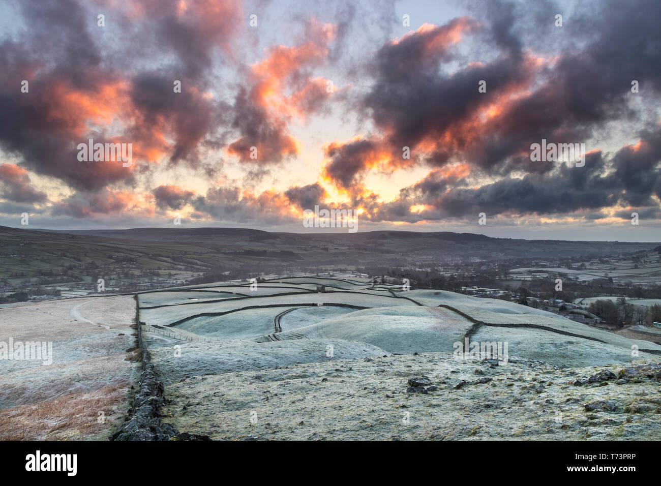 A Frosty Sunrise Viewed from the Ancient Tumulus of Kirkcarrion, Lunedale, Teesdale, County Durham, UK Stock Photo