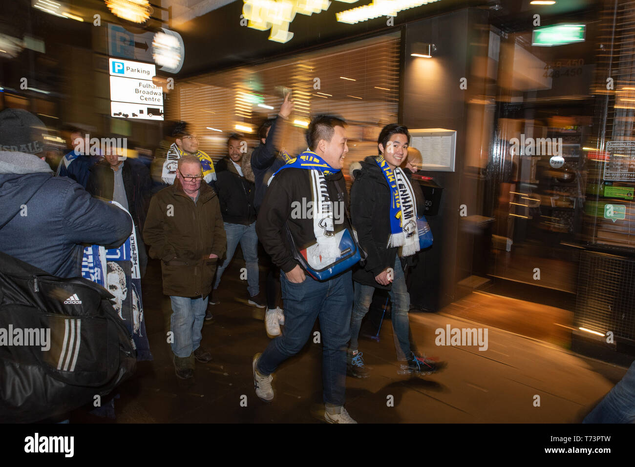 Asian supporters arrive at a game between Chelsea and Tottenham Hotspur. 24 janvier 2019 - Stock Image