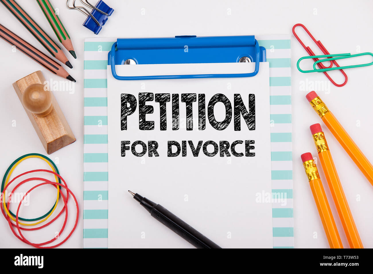 Petition for Divorce. White office desk with stationery - Stock Image
