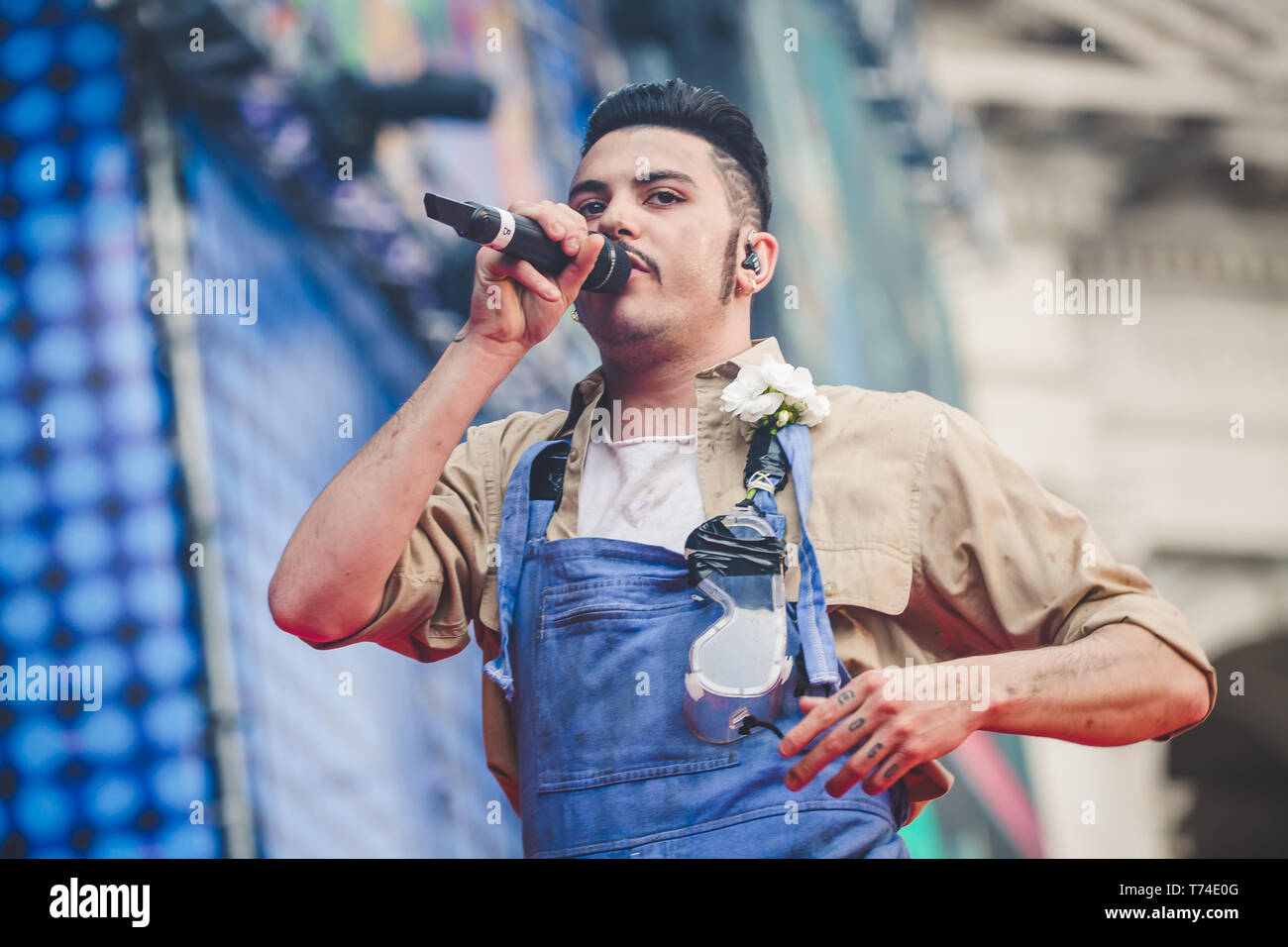 "Rome, Italy. 01st May, 2019. Izi, pseudonym of Diego Germini, rapper, singer-songwriter and Italian record producer, performed live on the stage of Primo Maggio Concert. The ""May Day"" Concert is an event organized every year in Rome by the labor unions CGL, CISL and UIL to celebrate workers' rights with music. Credit: Luigi Rizzo/Pacific Press/Alamy Live News Stock Photo"