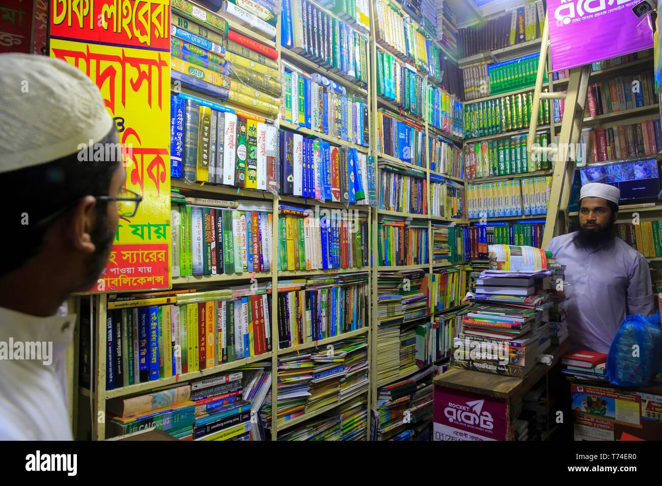 An Islamic bookshop at Nilkhet Book MArket. Dhaka, Bangladesh. - Stock Image