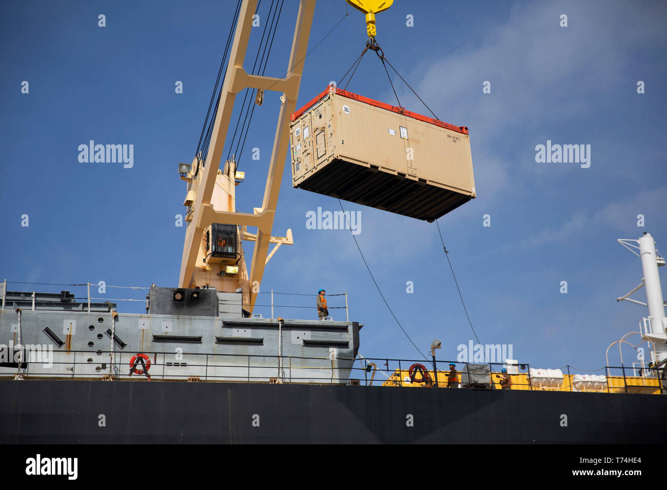 An intermodal container is lifted by crane to be staged onto the USNS William R. Button during a pier side equipment backload at Port Hueneme, Calif., as part of Exercise Pacific Blitz 19, March 12. Pacific Blitz 19 is designed to train Marines and Sailors in maritime prepositioning force operations and aims to increase proficiency, expand levels of cooperation and to enhance maritime capabilities. (U.S. Marine Corps photo by Cpl. Jacob A. Farbo) - Stock Image