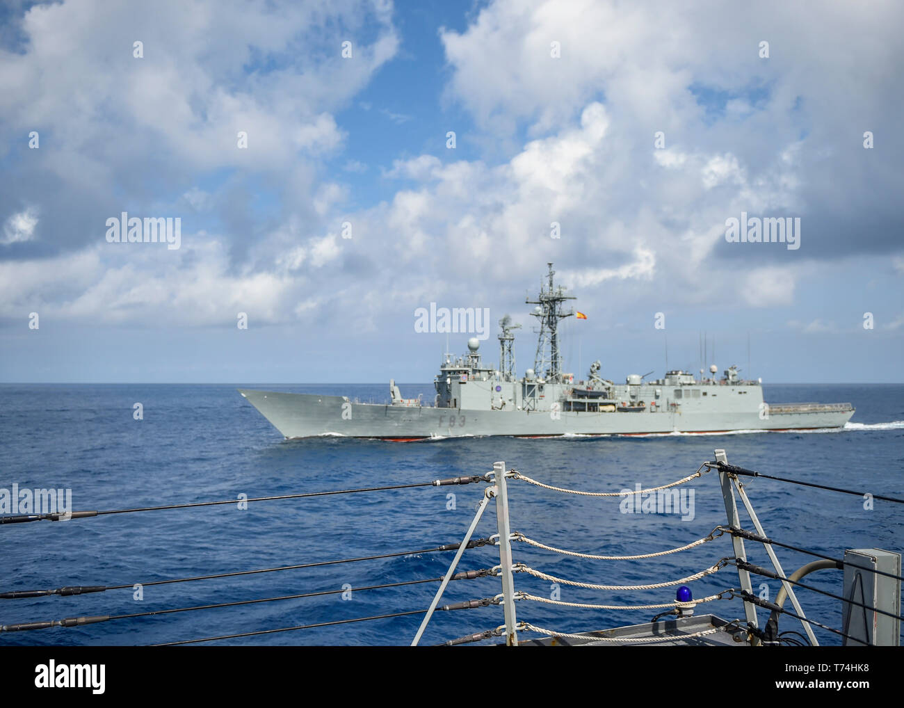 190501-N-SS350-0001 IONIAN SEA (May 1, 2019) The Spanish Santa Maria-class frigate Numancia (F 83) pulls alongside the Arleigh Burke-class guided-missile destroyer USS Bainbridge (DDG 96). Bainbridge is underway as part of the Abraham Lincoln Carrier Strike Group (ABECSG) deployment in support of maritime security cooperation efforts in the U.S. 5th, U.S. 6th and U.S. 7th Fleet areas of operation. With Abraham Lincoln as the flagship, deployed strike group assets include staffs, ships and aircraft of Carrier Strike Group 12 (CSG 12), Destroyer Squadron 2 (DESRON 2) and Carrier Air Wing 7 (CVW  - Stock Image