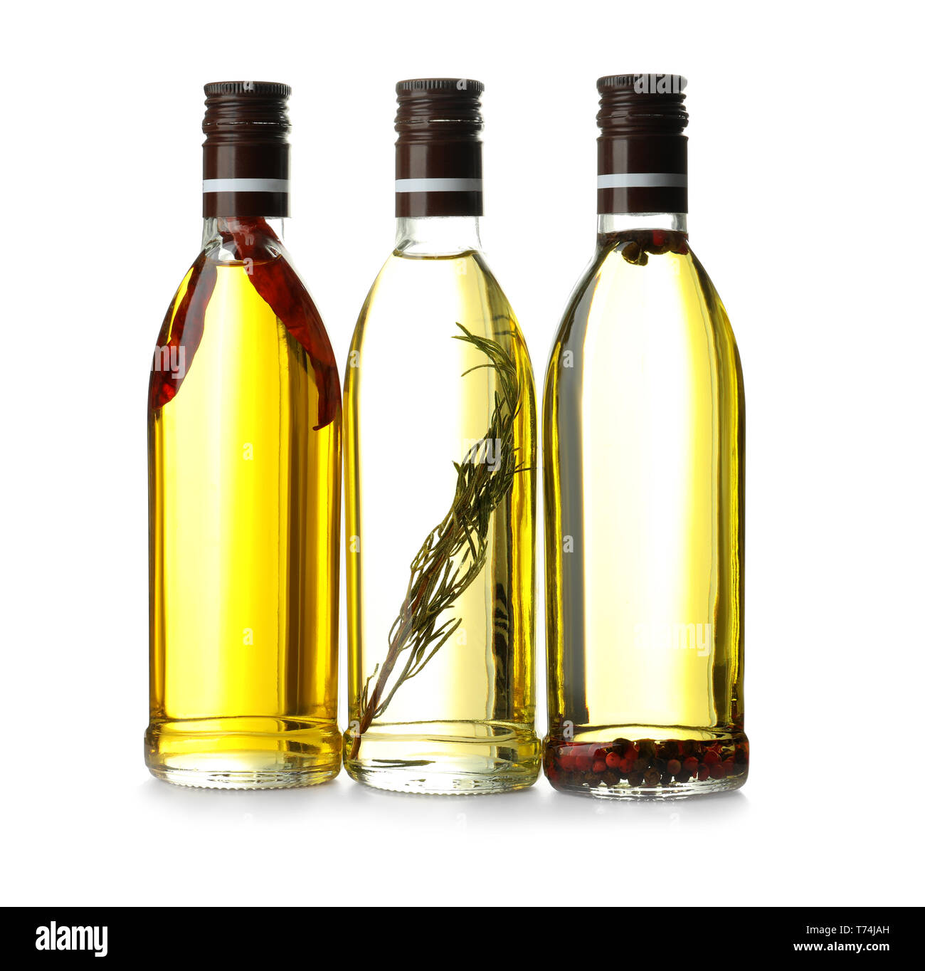 Glass Bottles With Olive Oil On White Background Stock Photo