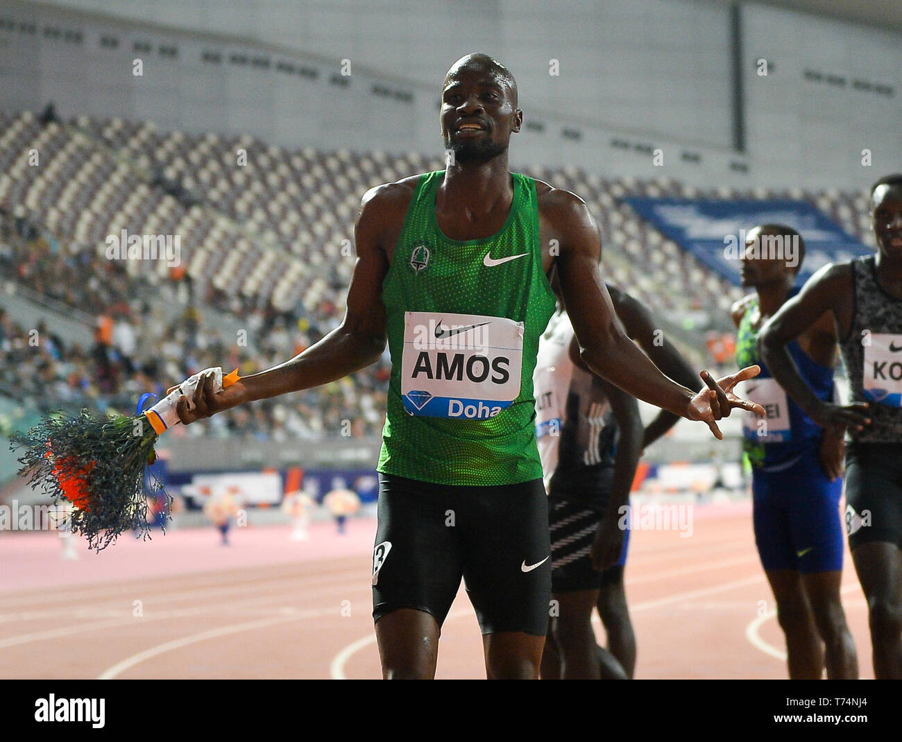 Doha, Qatar. 3rd May, 2019. Nijel Amos of Botswana celebrates after the men's 800m final at 2019 IAAF Diamond League at Khalifa International Stadium in Doha, Qatar, May 3, 2019. Nijel Amos won the gold medal with 1 minute and 44.29 seconds. Credit: Nikku/Xinhua/Alamy Live News - Stock Image